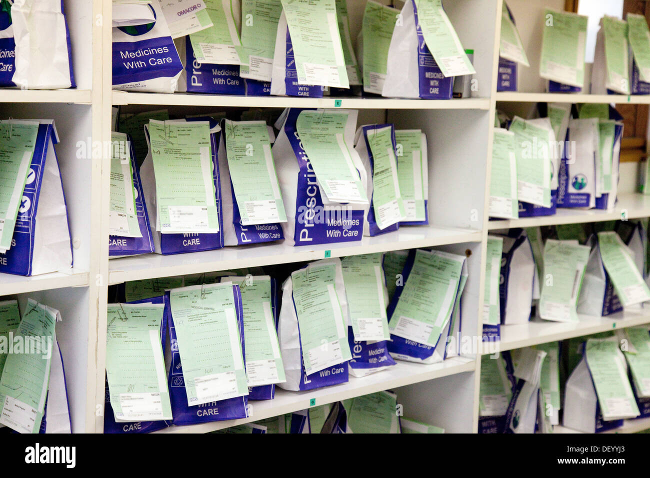 NHS Prescription medicines waiting to be collected on a chemist pharmacy shelves, Suffolk, England, UK - Stock Image