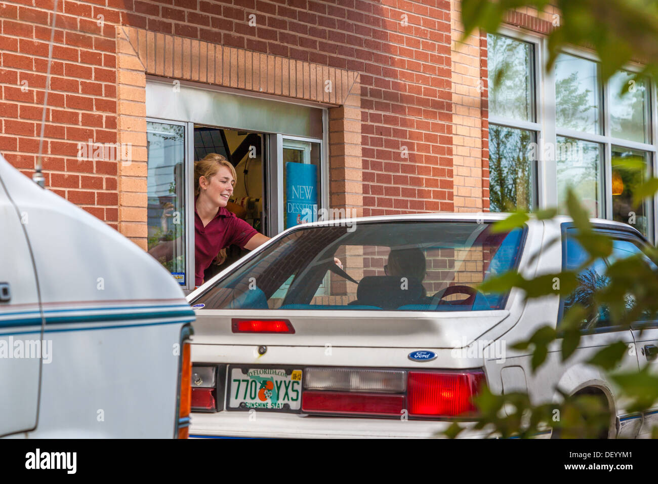 Cars at the drive through window at the Chick-fil-a fast food restaurant in Ocala, Florida in support of Christian values - Stock Image