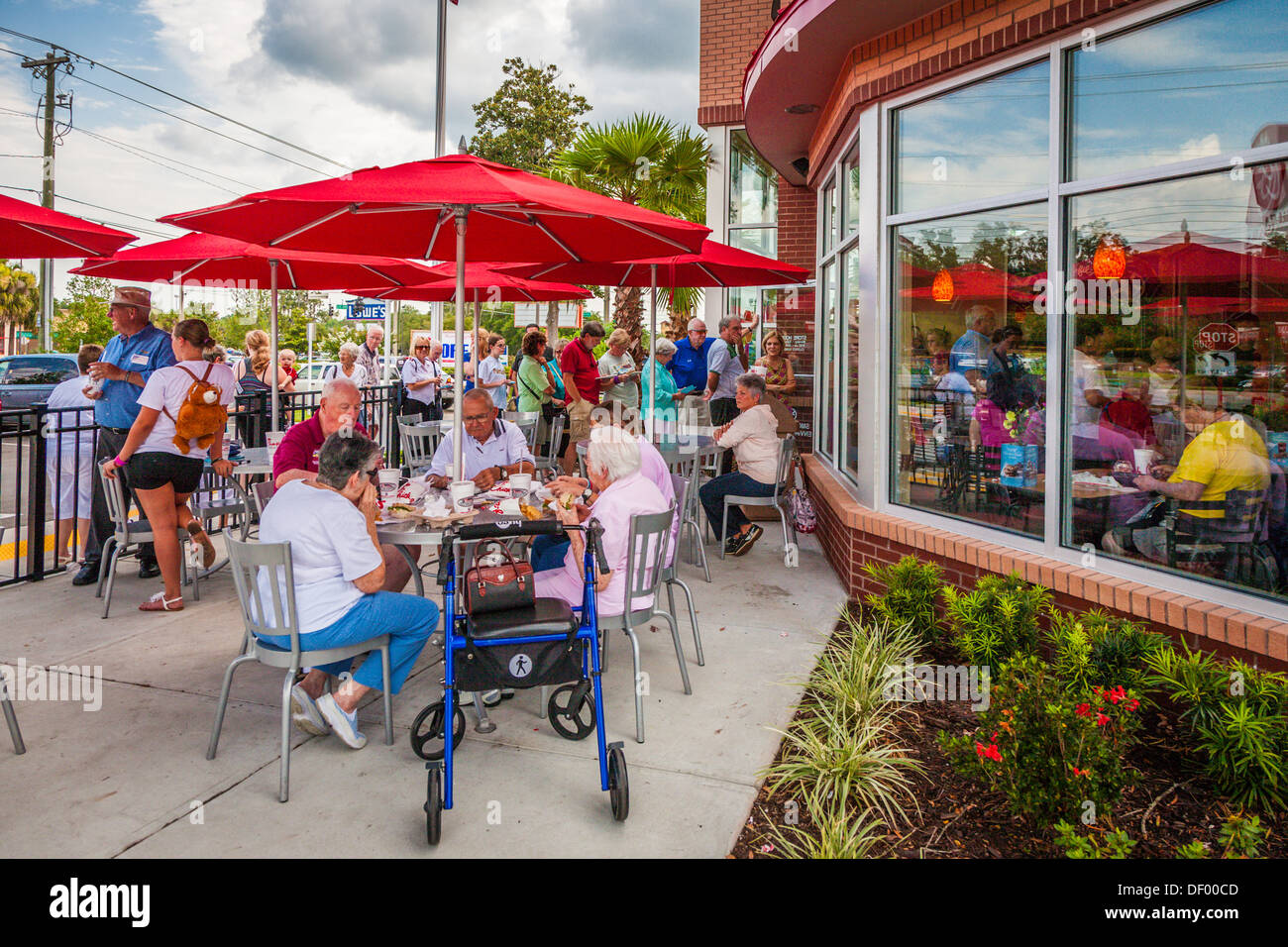 Senior customers eating in front of the Chick-fil-a fast food restaurant in Ocala, Florida in support of Christian values - Stock Image