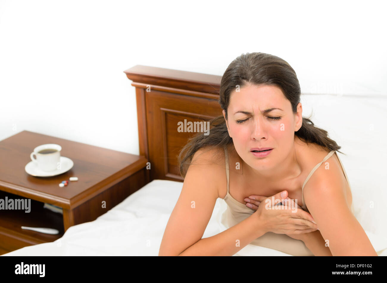 Young woman suffering a heartache - Stock Image