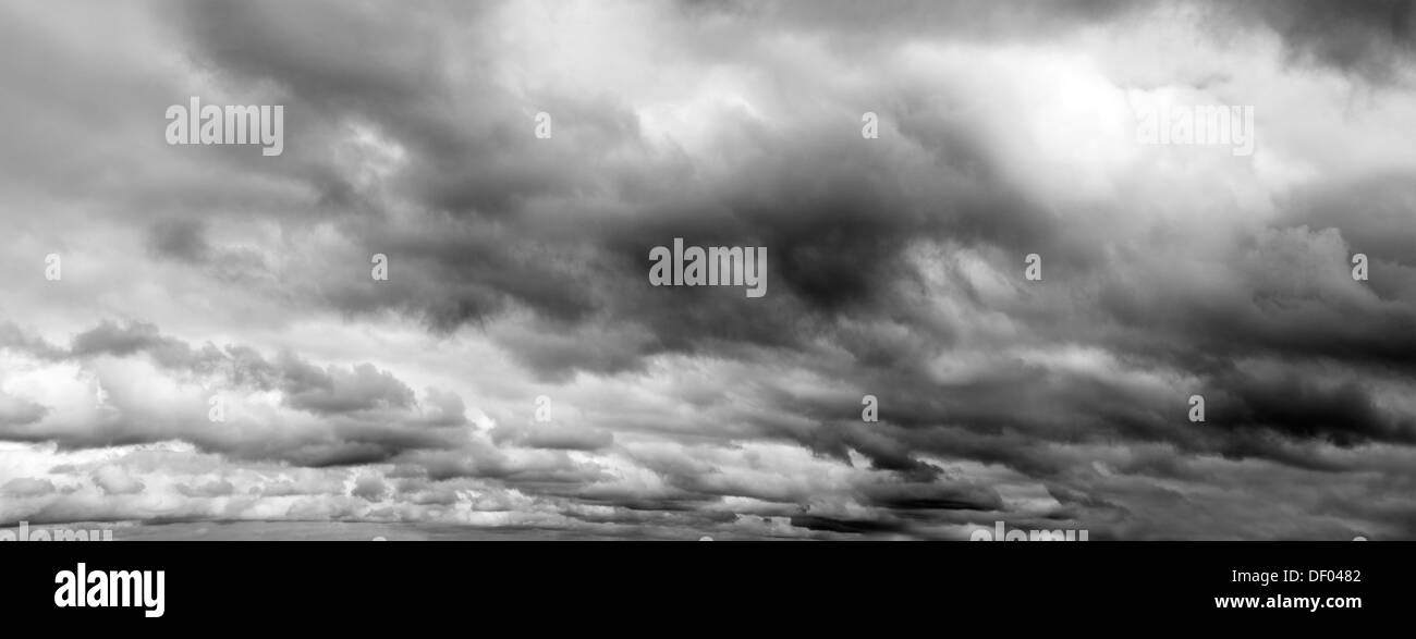 Grey overcast storm clouds sky - Stock Image