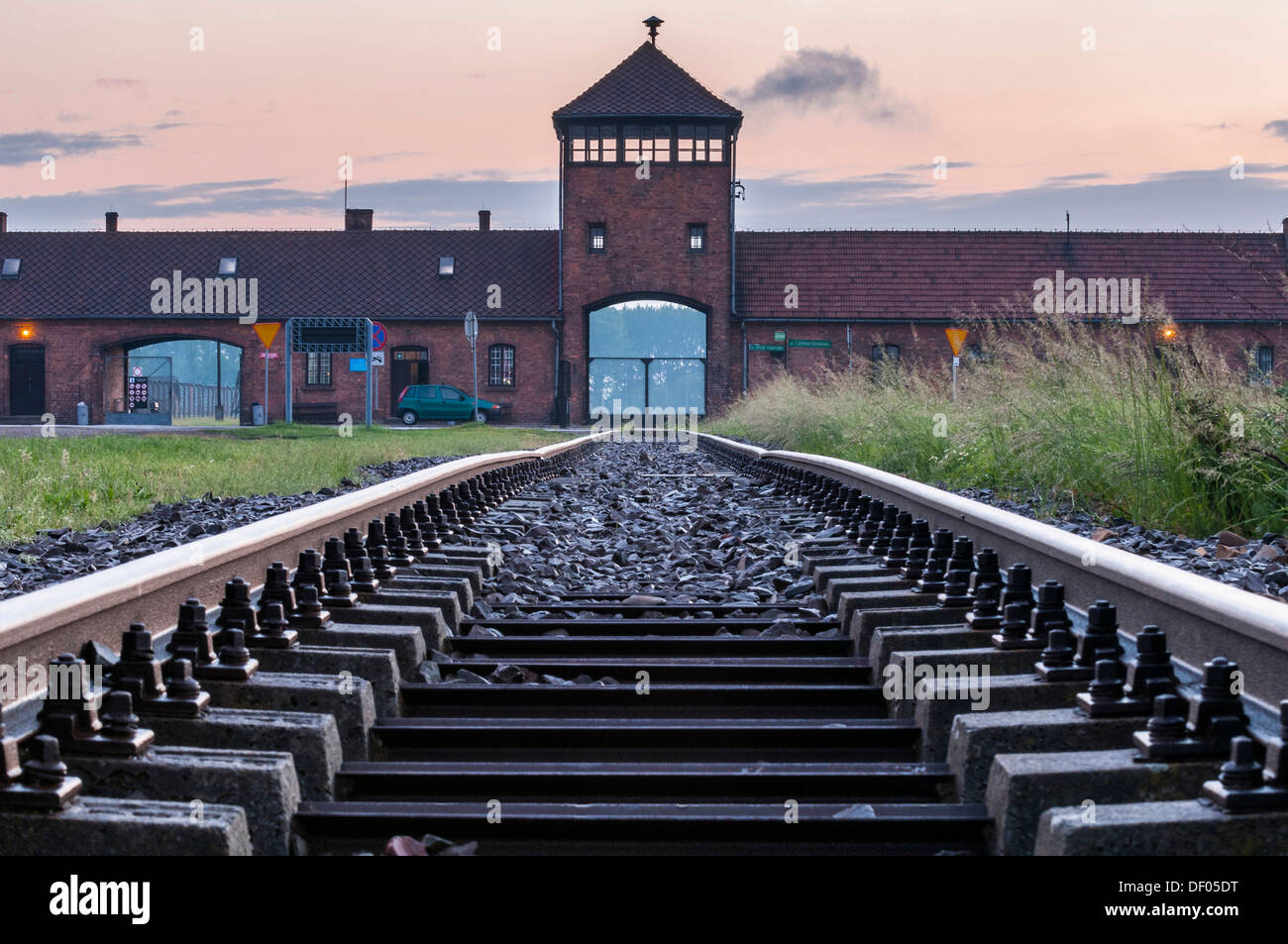 Rail tracks and entrance gate to the Auschwitz-Birkenau concentration camp, Auschwitz, Lesser Poland, Poland, Europe - Stock Image