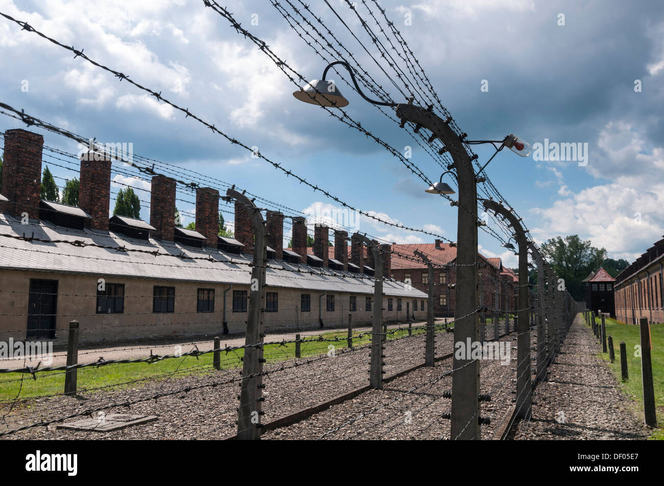 Barbed wire fence and barracks, Auschwitz I concentration camp, Auschwitz, Lesser Poland, Poland, Europe - Stock Image