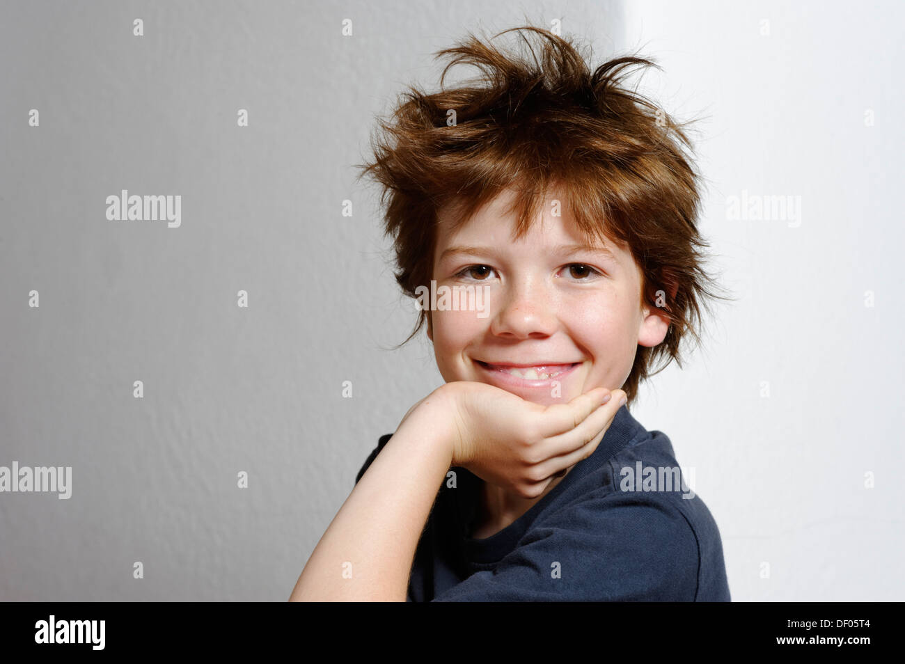 Boy, 12 years old, with tousled hair - Stock Image