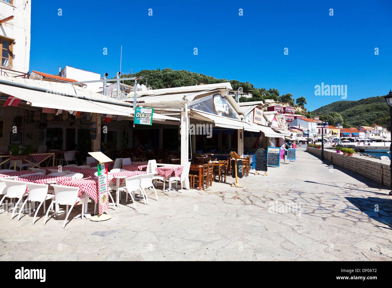 Taverna restaurants harbour front Parga town Greek Greece - Stock Image