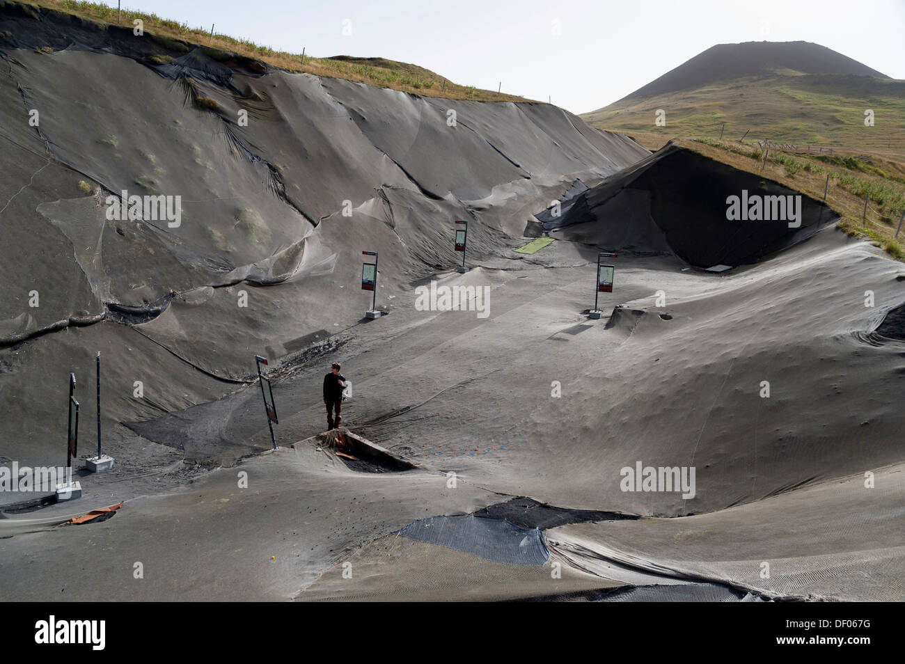 Excavations on a lava field, destroyed houses covered with plastic sheets, Pompeii of the North project, town of Vestmannaeyjar - Stock Image