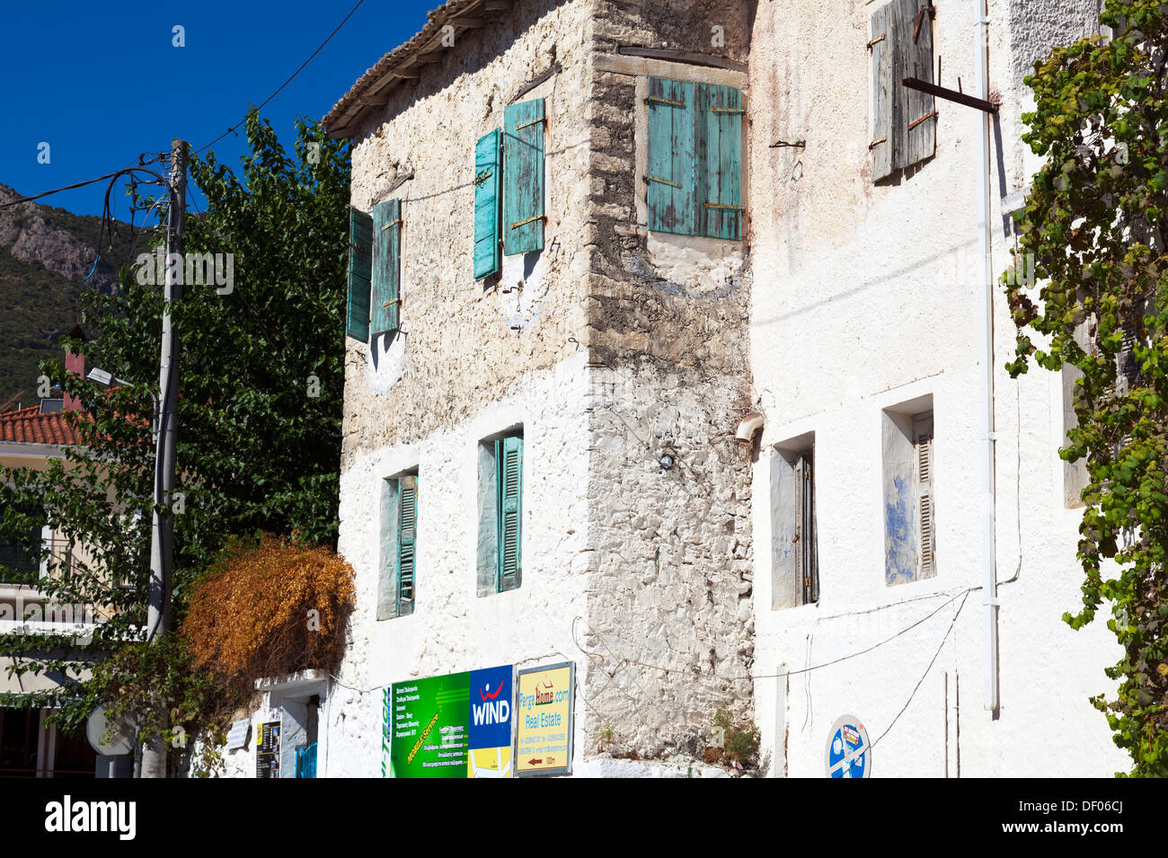 typical neglect of top of buildings in Greece run down derelict left to rot Parga town Greek - Stock Image
