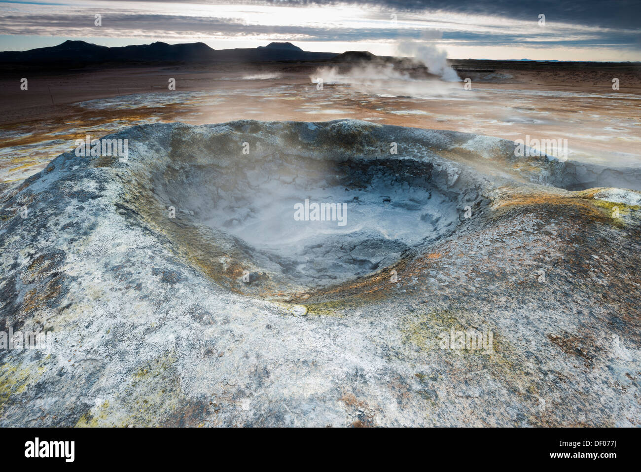 Solfataras, fumaroles, mud pools, sulfur and other minerals, steam, Hveraroend geothermal area, Námafjall mountains - Stock Image