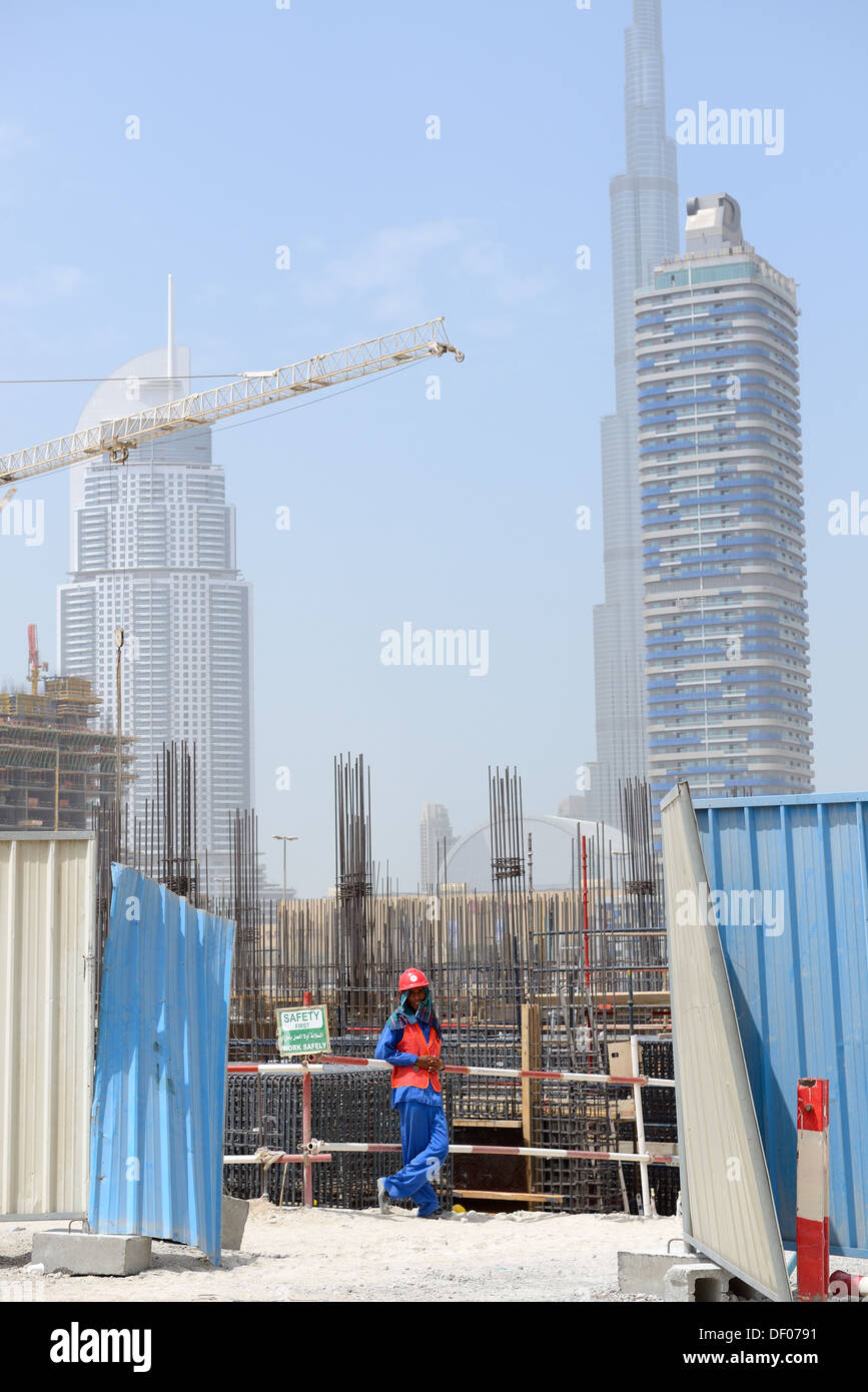 A worker on construction site in Dubai down town Stock Photo