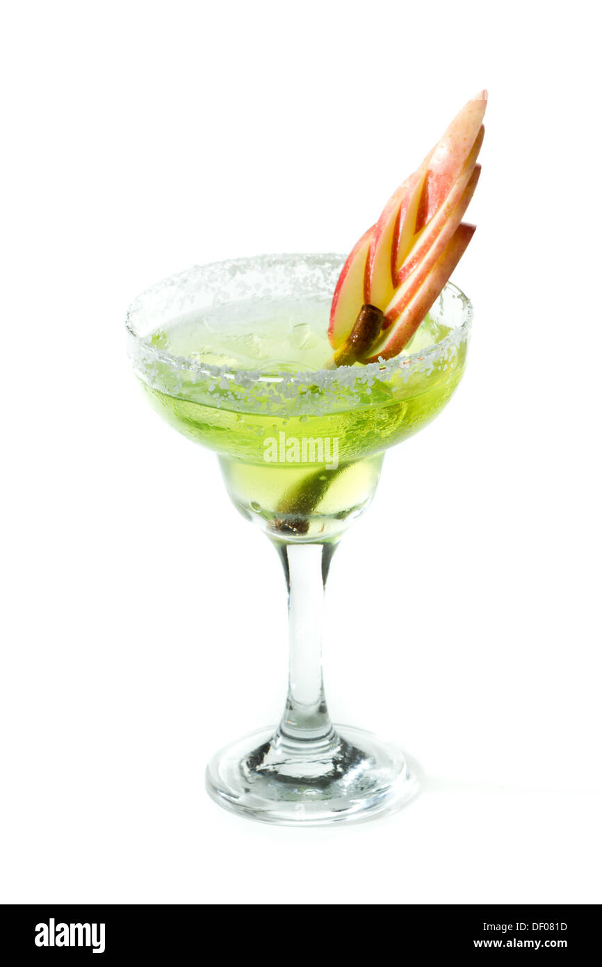 apple margarita isolated on a white background with apple slices and a cinnamon stick - Stock Image
