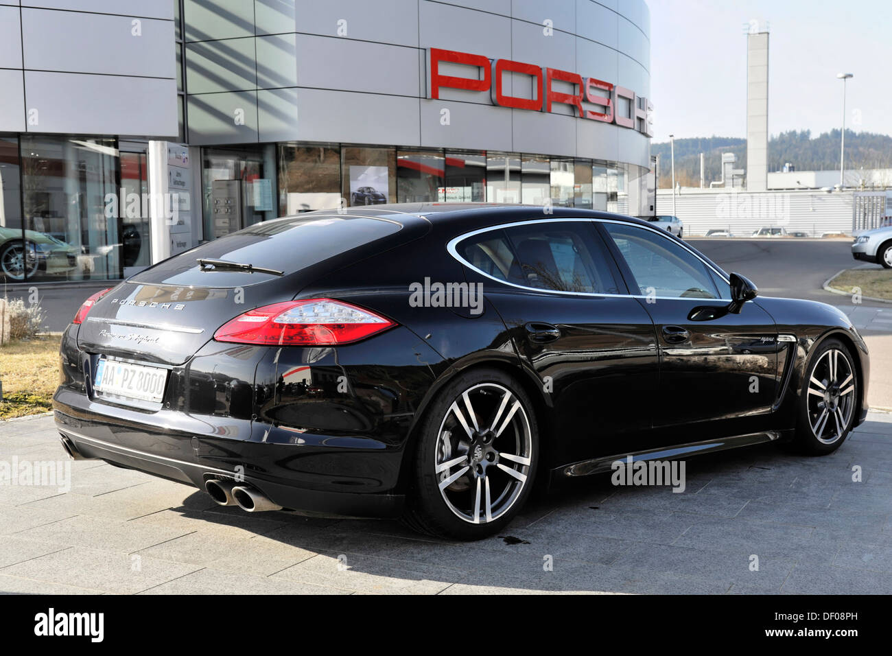 Porsche Panamera Hybrid S in front of showrooms of Porsche Center Schwaebisch Gmuend, during the new presentation 2012 - Stock Image