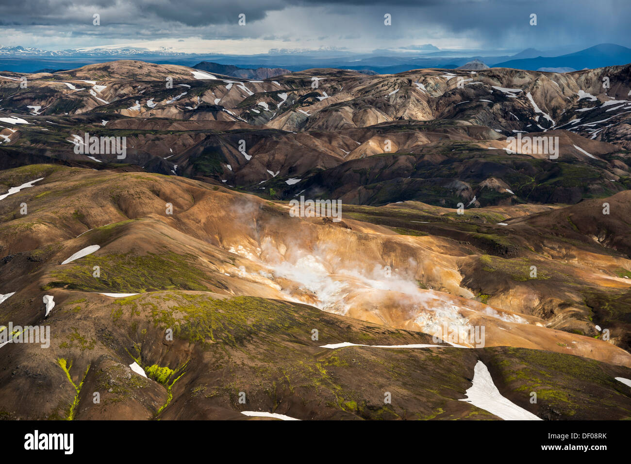 Aerial view, high-temperature area, geothermal area, rhyolite mountains partially covered with snow, Landmannalaugar - Stock Image