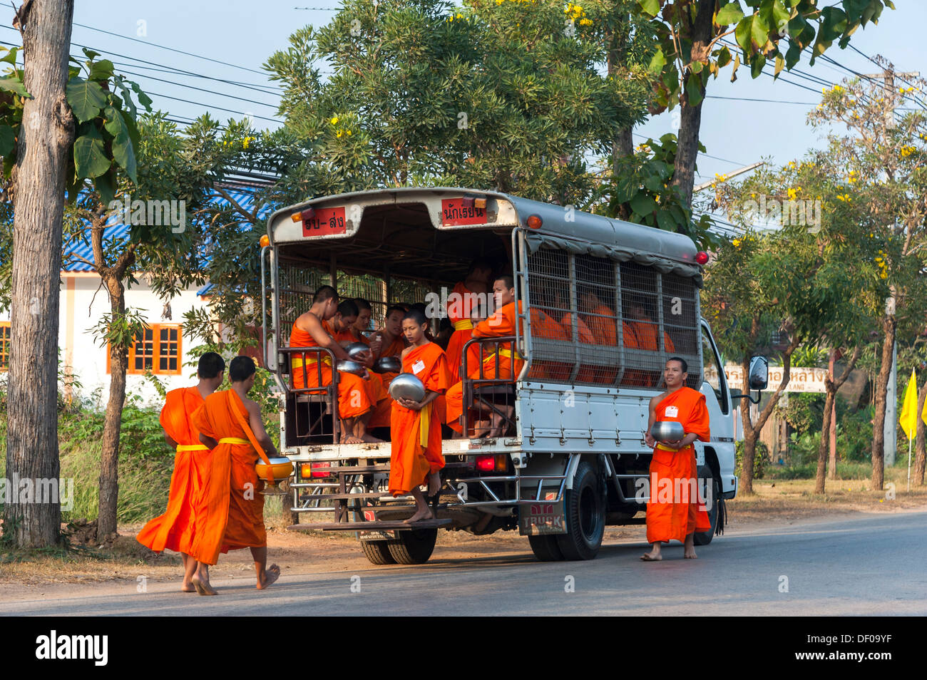 Songthaeo or songthaew, converted vehicle with young Buddhist monks from monastery school, Sukhothai province, Thailand, Asia - Stock Image