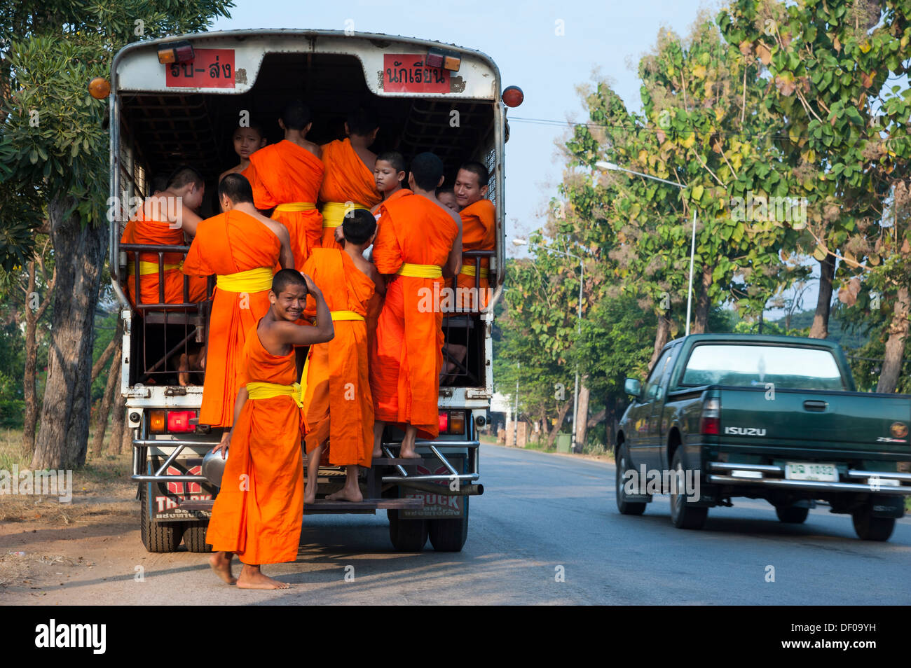 Songthaeo or songthaew, converted vehicle with young Buddhist monks from a monastery school, Sukhothai Province, Thailand, Asia - Stock Image