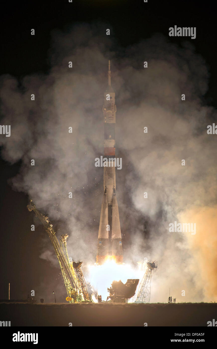 International Space Station Expedition 37 flight crew lift off on the Soyuz TMA-10M rocket launch at the Baikonur Cosmodrome September 26, 2013 in Baikonur, Kazakhstan. - Stock Image