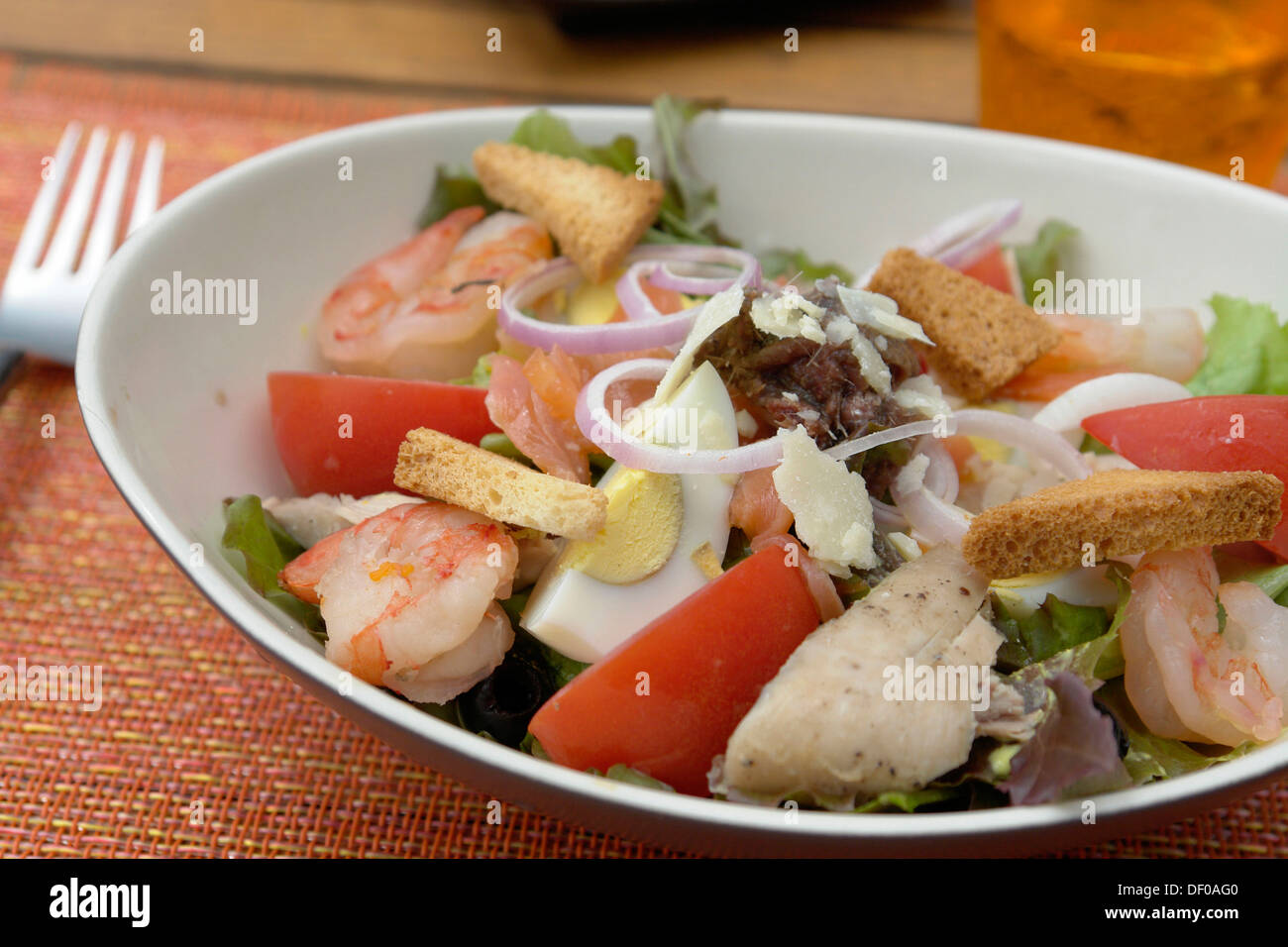 Cesar Salad with lettuce, tuna, anchovies, shrimp, tomato, egg, Parmesan cheese, onions and croutons - Stock Image