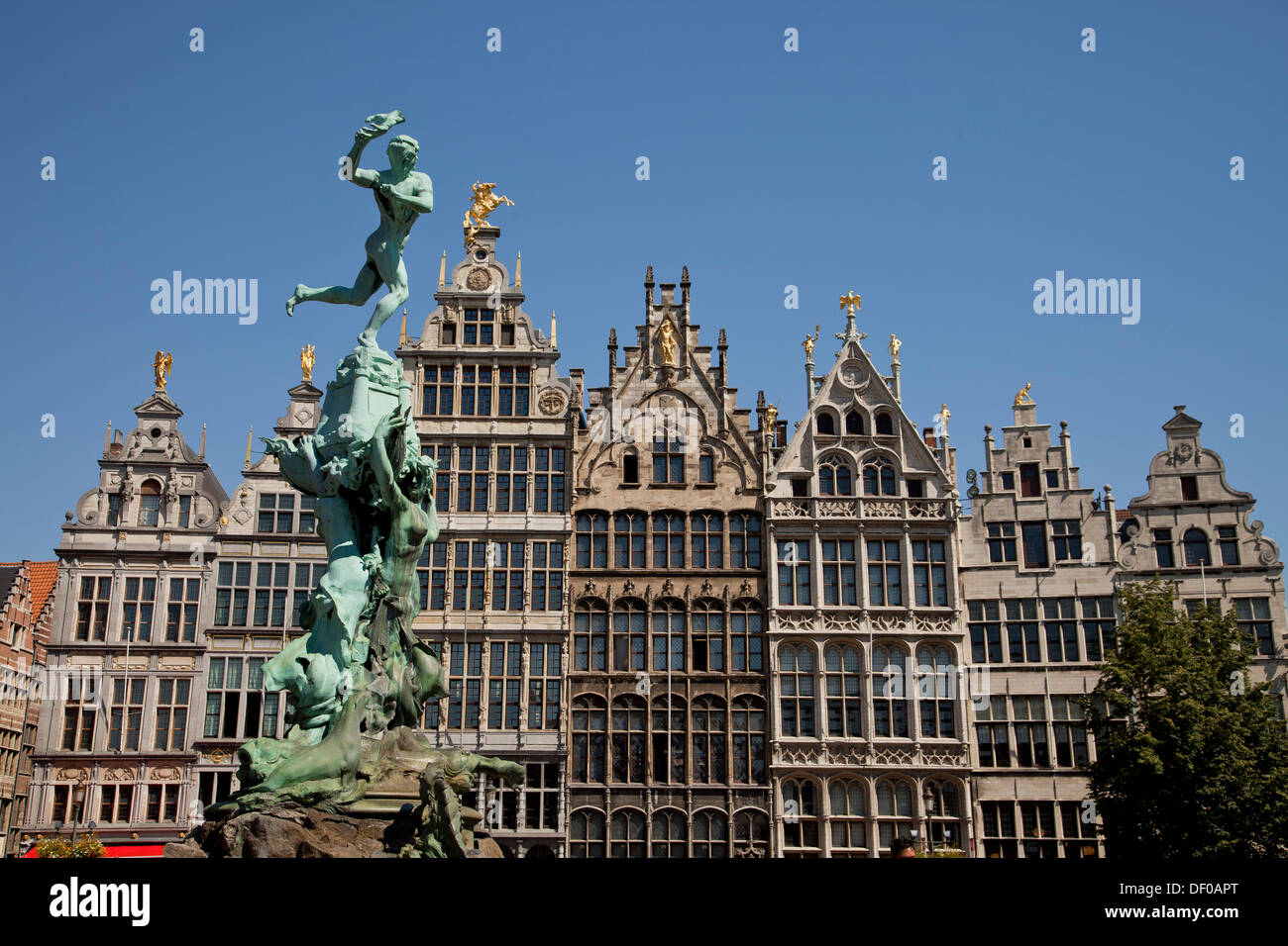 Statue of Brabo and the giant's hand fountain and 16th-century Guildhouses at the market square Grote Markt in Antwerp, Belgium, - Stock Image