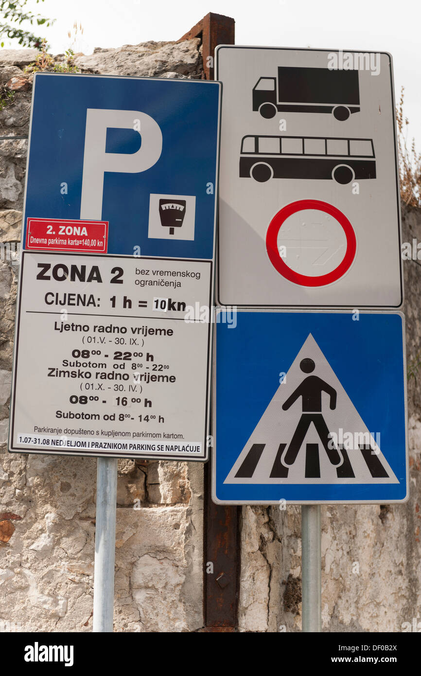 Traffic signs with parking charges at the wall of the historic town centre, Zadar, Dalmatia, Croatia, Southern Europe, Europe - Stock Image