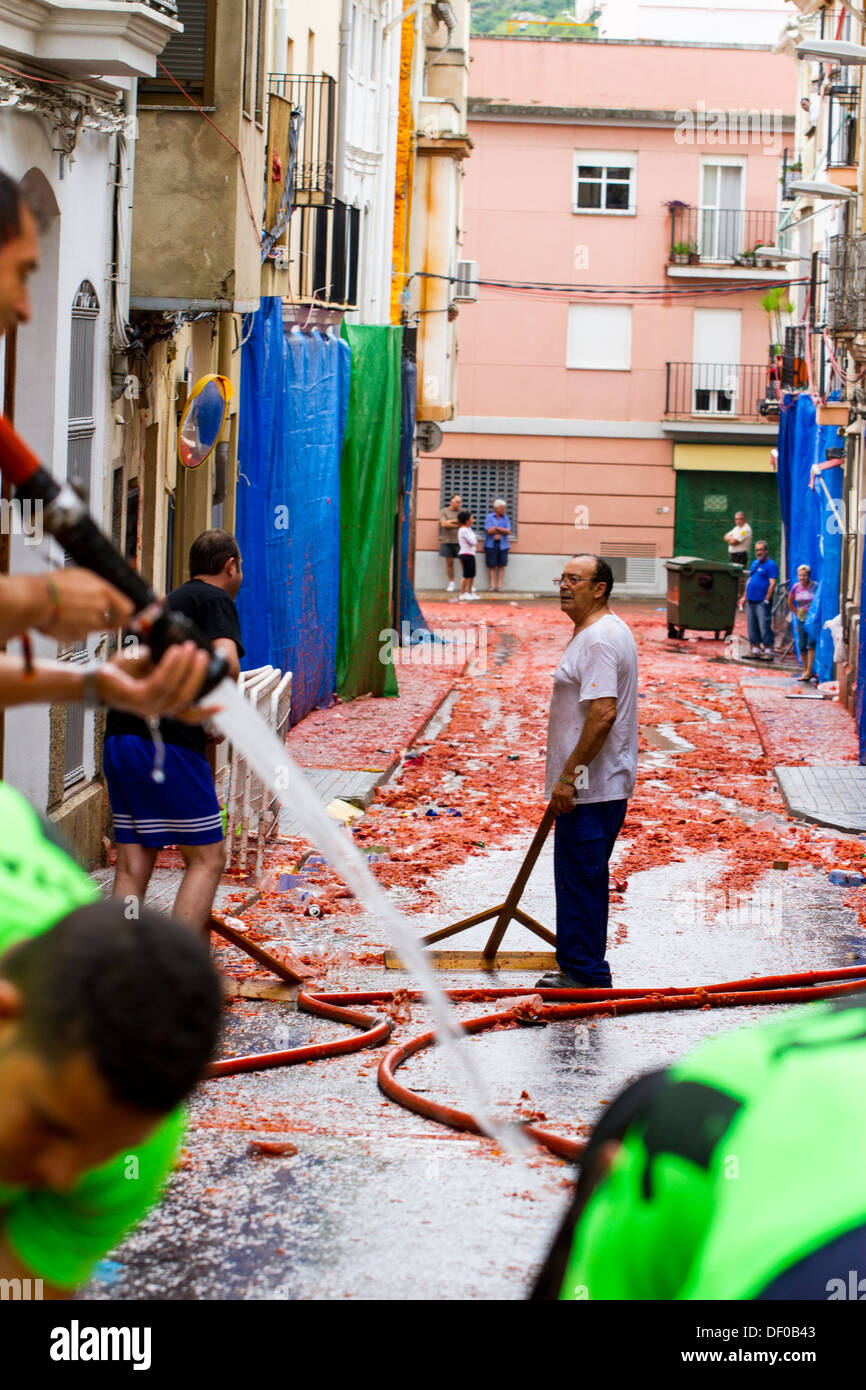 The cleanup after Tomatina - Stock Image