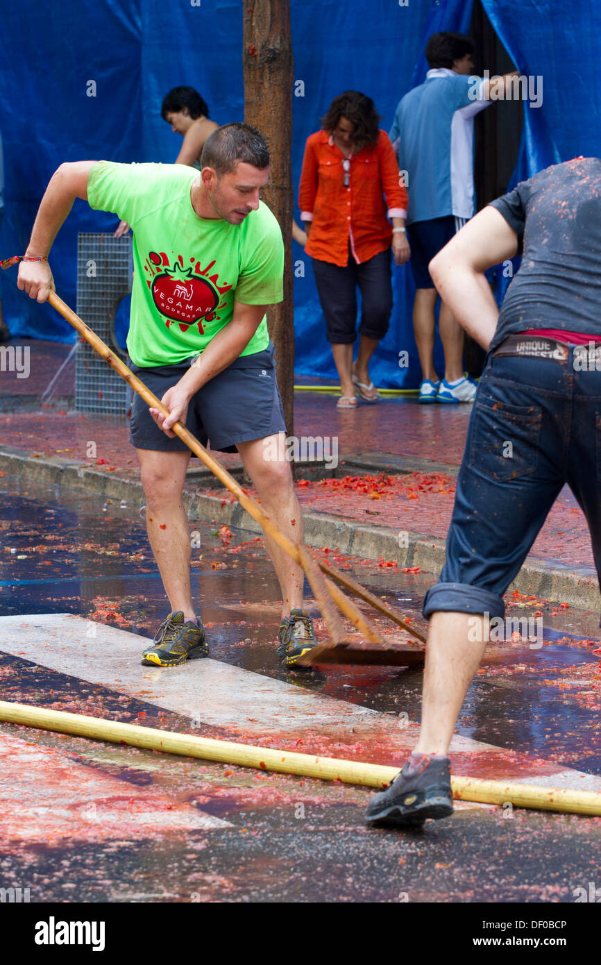Sweeping after Tomatina - Stock Image