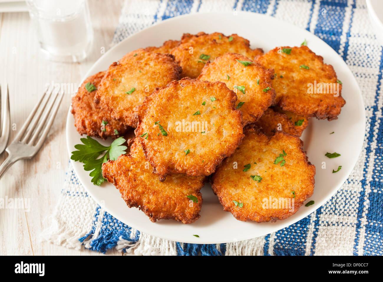 Homemade Traditional Potato Pancake Latke on a Background - Stock Image