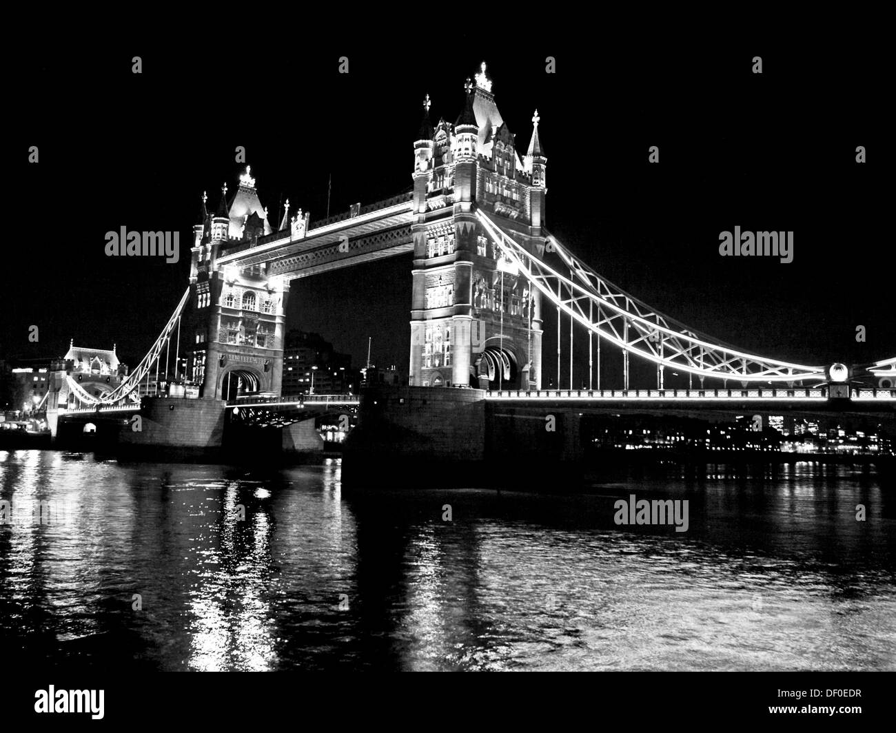 View of the Tower Bridge at night showing the River Thames, London, England, United Kingdom - Stock Image