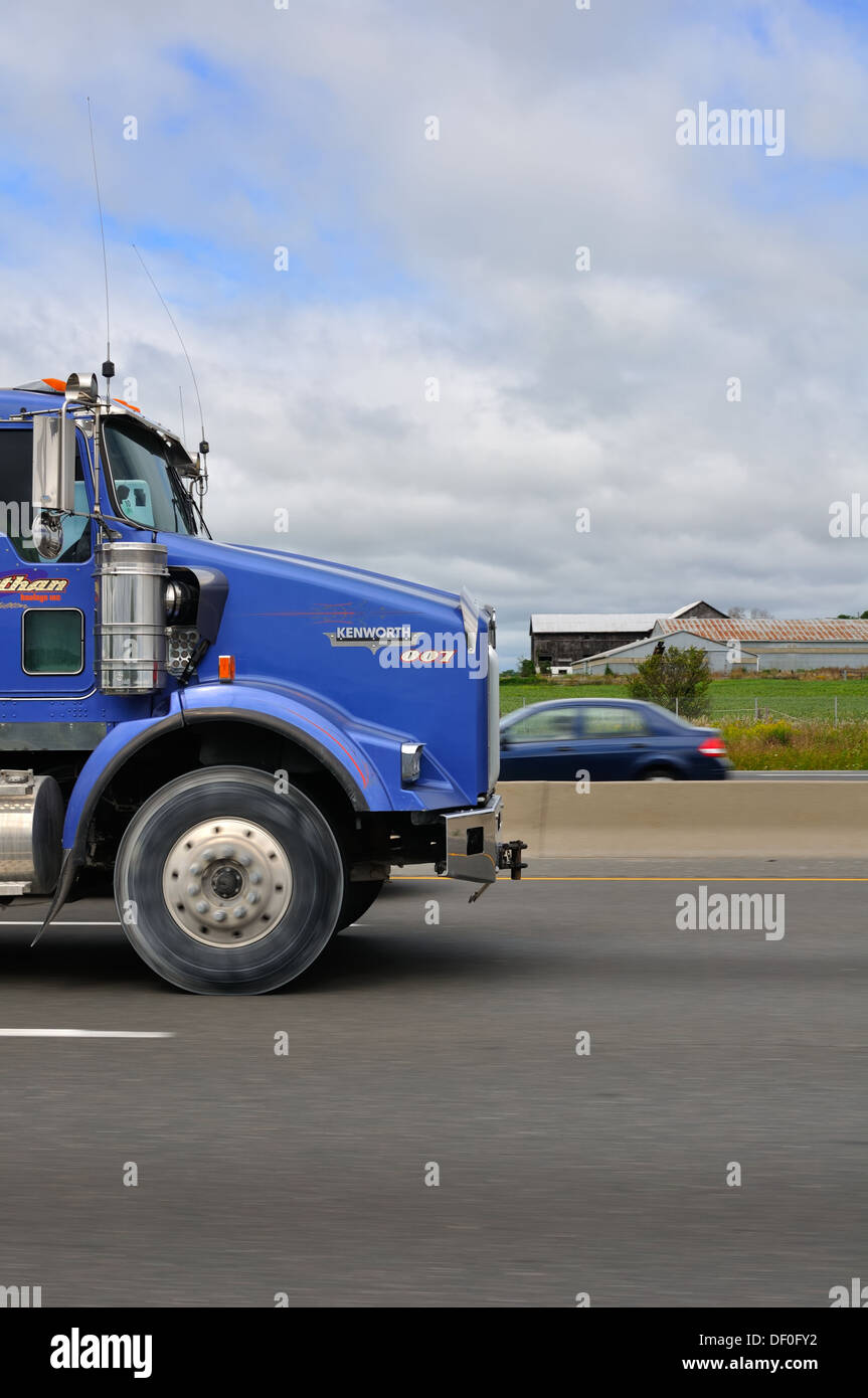 Front of truck on a Canadian highway. - Stock Image