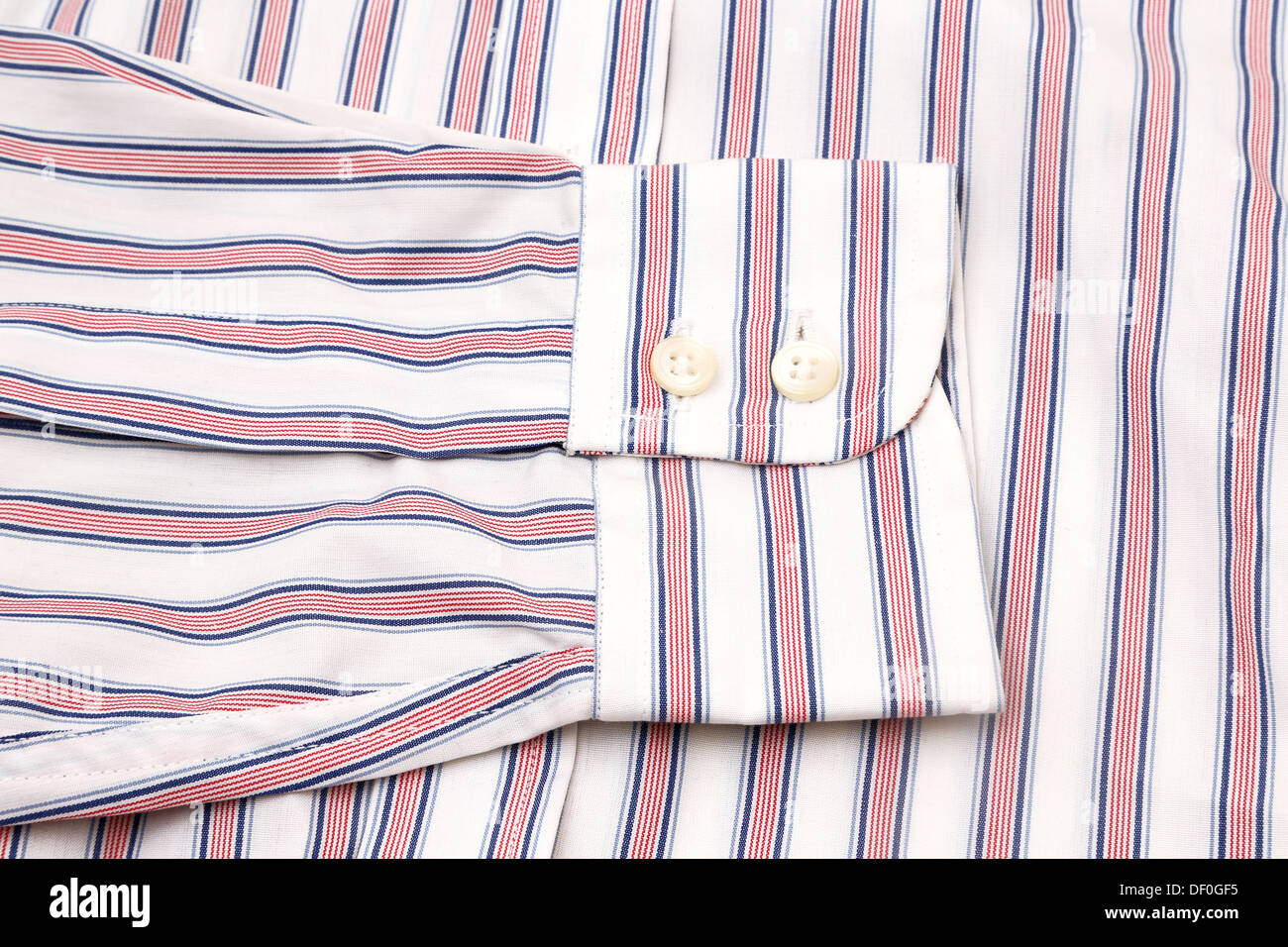 Red, White And Blue Striped Shirt Cuff Of Sleeve - Stock Image