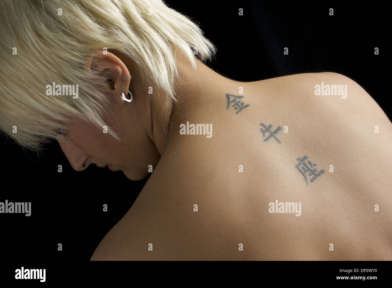 Herne, Germany, a woman tattooed Ruecken Stock Photo
