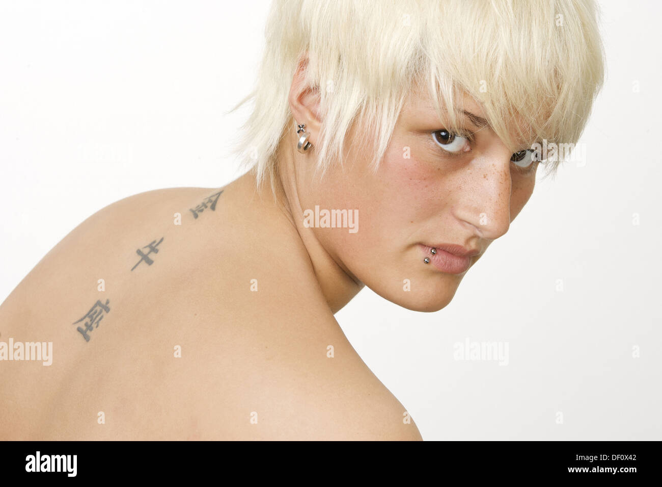 Herne, Germany, Portrait photo of a tattooed and pierced woman Stock Photo