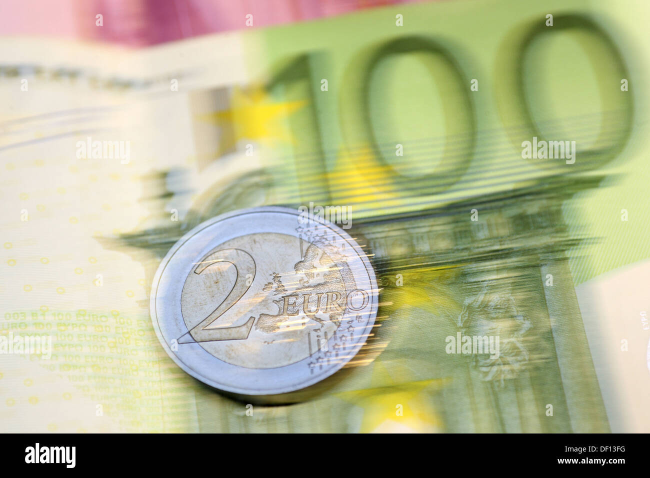 Berlin, Germany, the coin is on a banknote Stock Photo