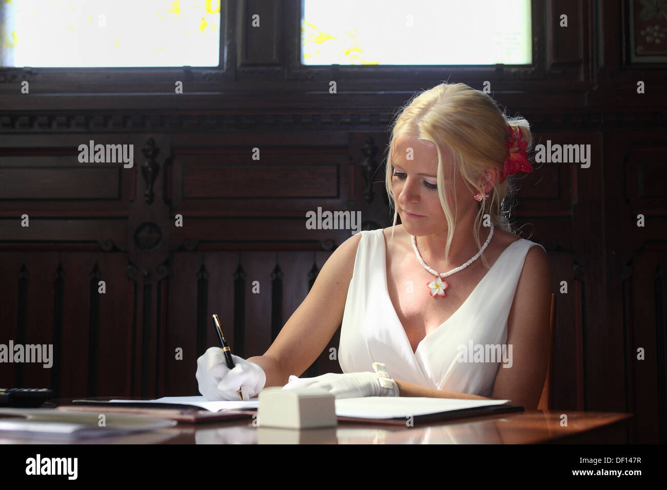 Berlin, Germany, the bride signs the Protocol of marriage - Stock Image