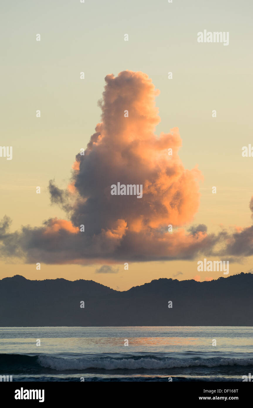 Cloud formation above Maewo Island at sunset, across the Coral Sea from Ambae Island, Vanuatu - Stock Image