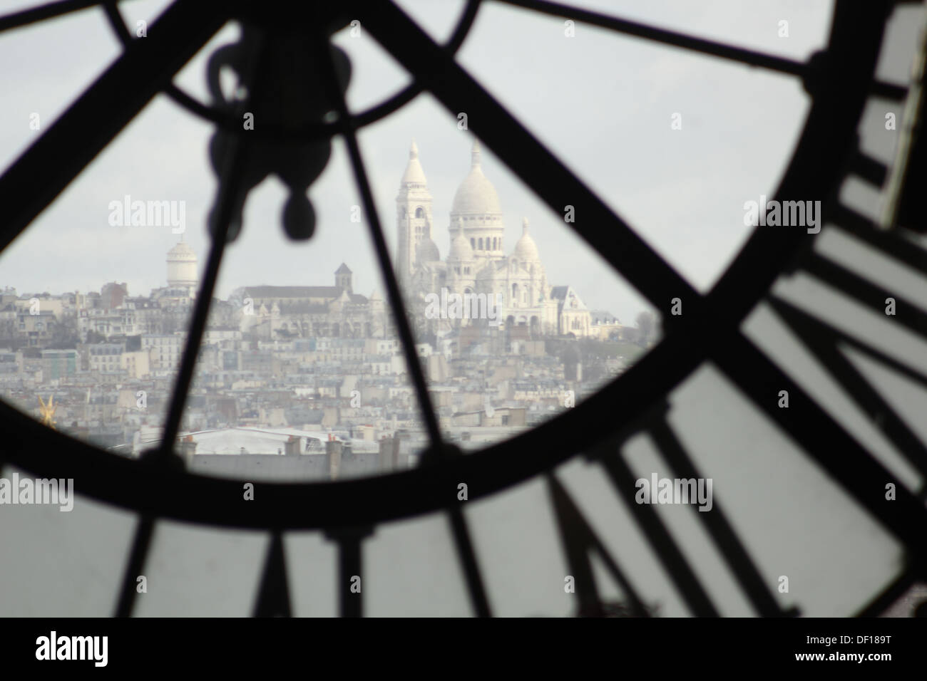 Montmartre through the clock window of Musee d'Orsay - Stock Image
