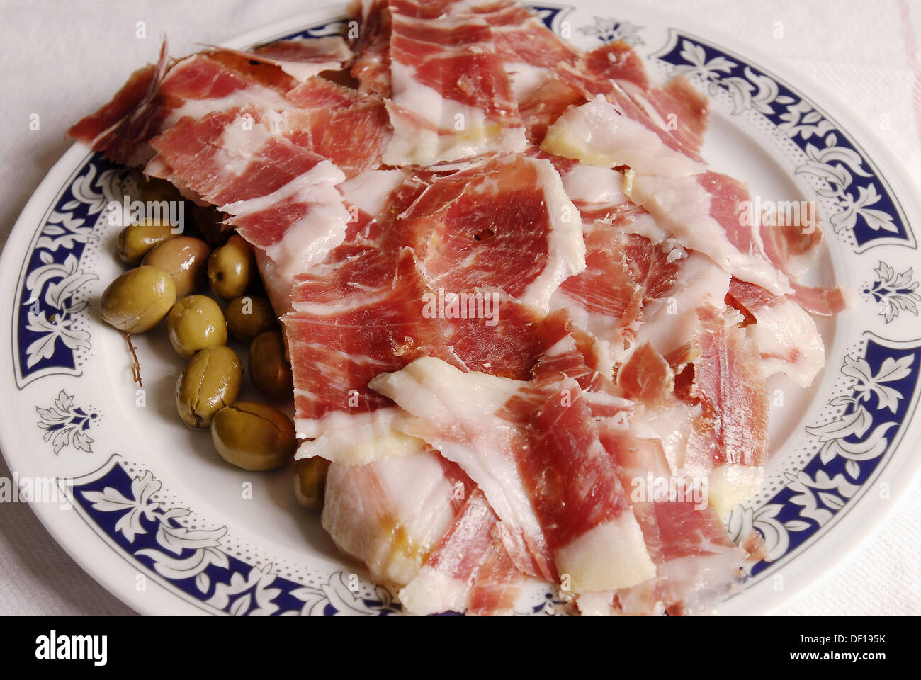 Jamon de Jabugo. Spanish ham is usually served sliced tissue-paper thin. Mediterranean Foods. Spain. - Stock Image