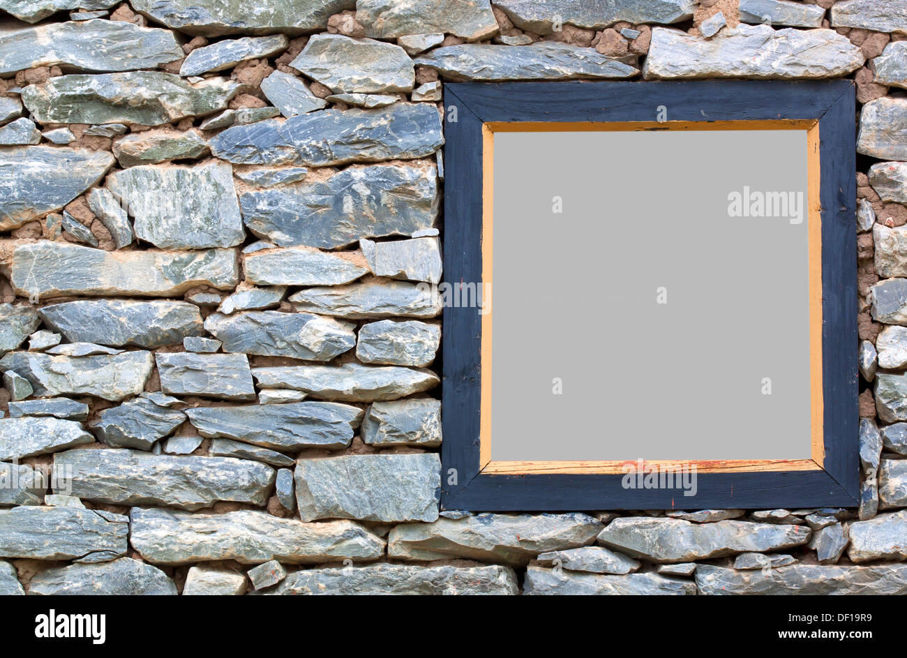 Old stone wall with a wood frame wall. - Stock Image