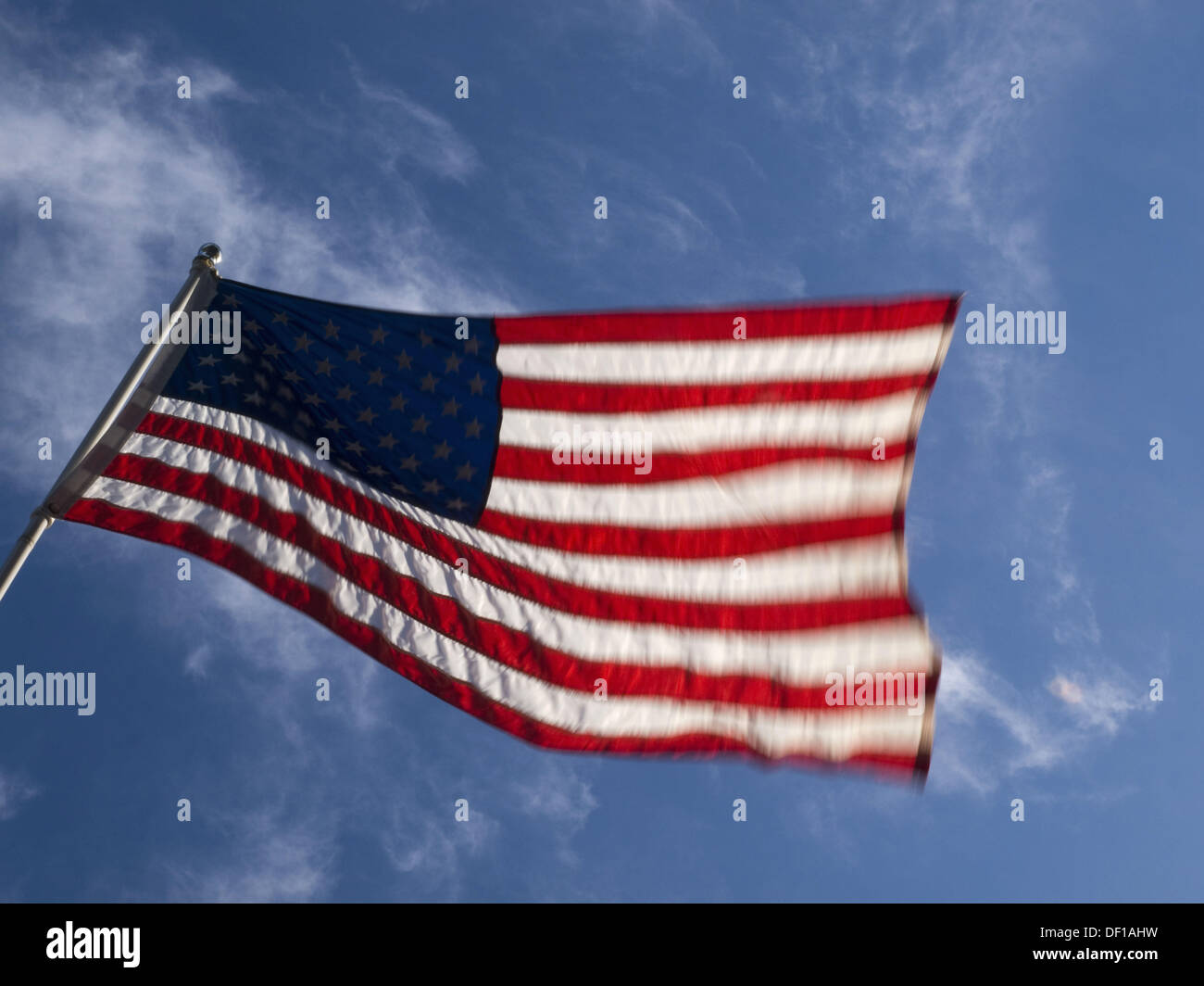 Flag blows in the wind in Hyannis, Massachussetts, USA - Stock Image
