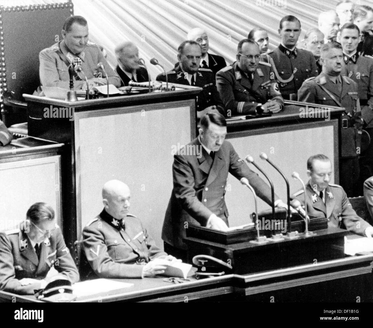 The image from the Nazi Propaganda! shows Reich Chancellor Adolf Hitler delivering a speech to the Reichstag in the Kroll Opera House in Berlin, Germany, 26 April 1942. During that session, a resolution of the Greater German Reichstag was passed that legitimized the Führerbefehl (Führer's Order) as the final decision making body without reference to formal principles of law. Photo: Berliner Verlag/Archiv - Stock Image