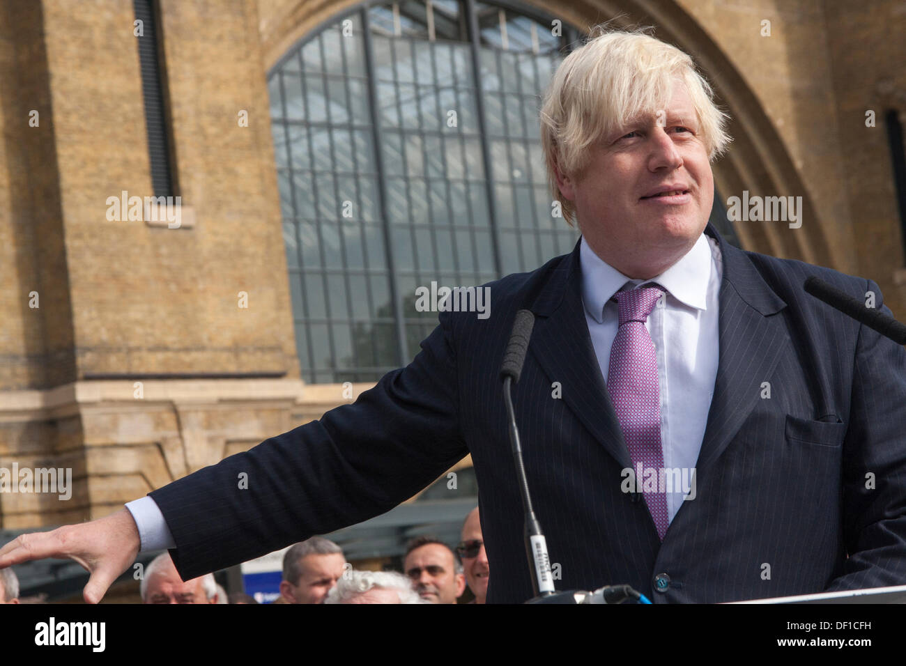 London, UK. 26th Sep, 2013. London Mayor Boris Johnson speaks at the official opening of Kings Cross Square following the station's £550m refurbishment. Credit:  Paul Davey/Alamy Live News - Stock Image