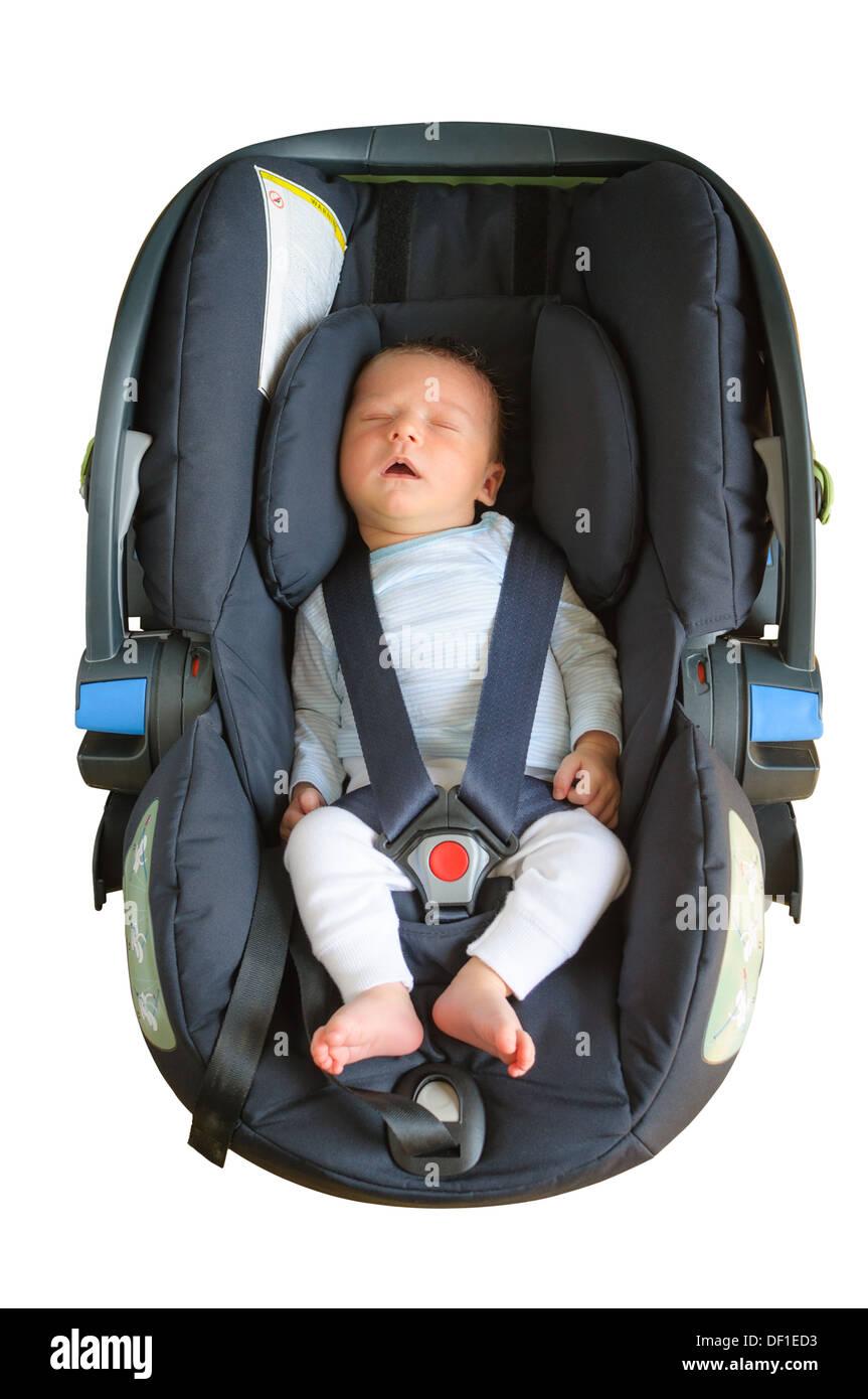 Newborn Boy Is Sleeping In A Car Seat