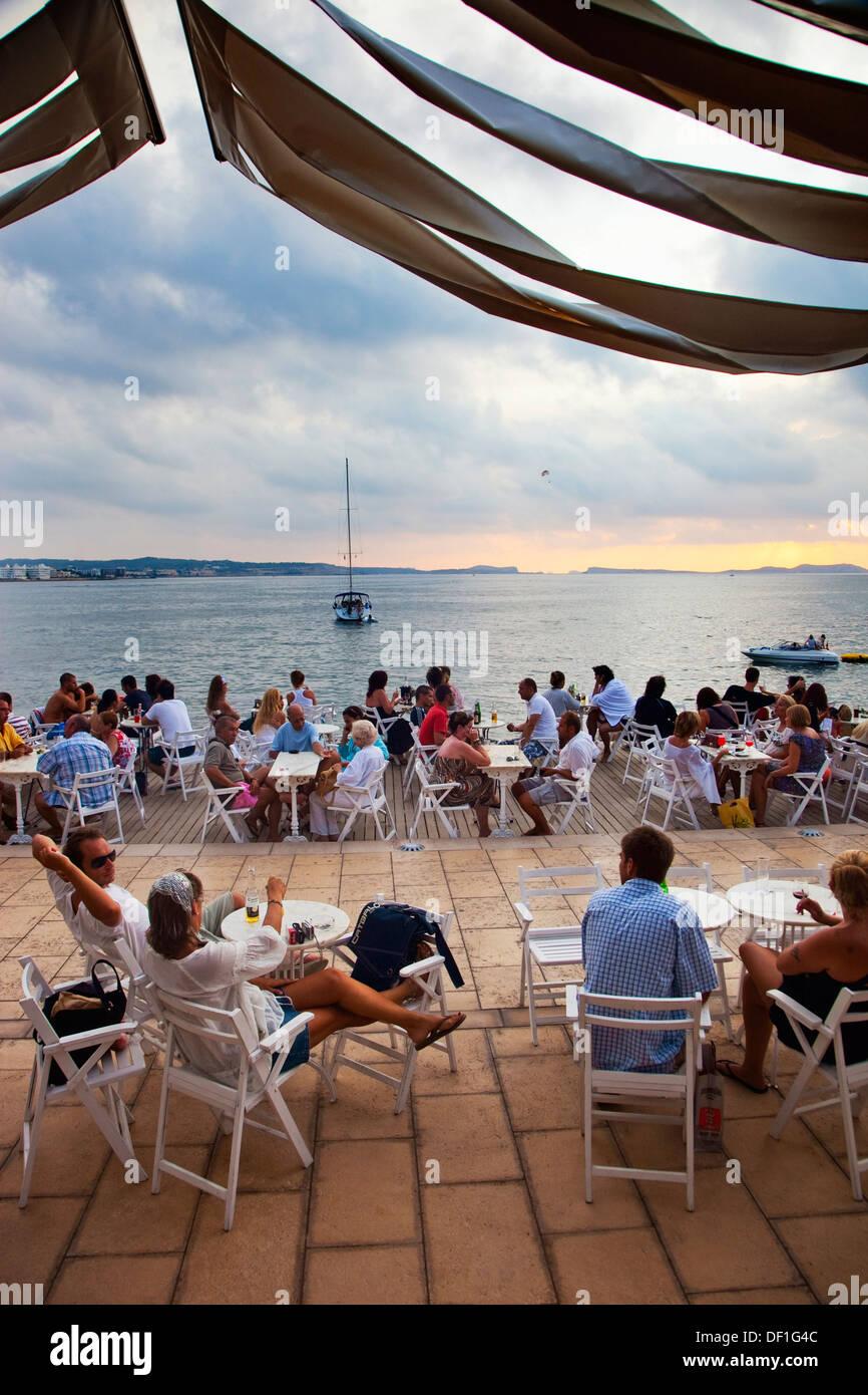 Sunset from Cafe del Mar. Sant Antoni de Portmany. Ibiza. Balearic Islands. Spain. - Stock Image