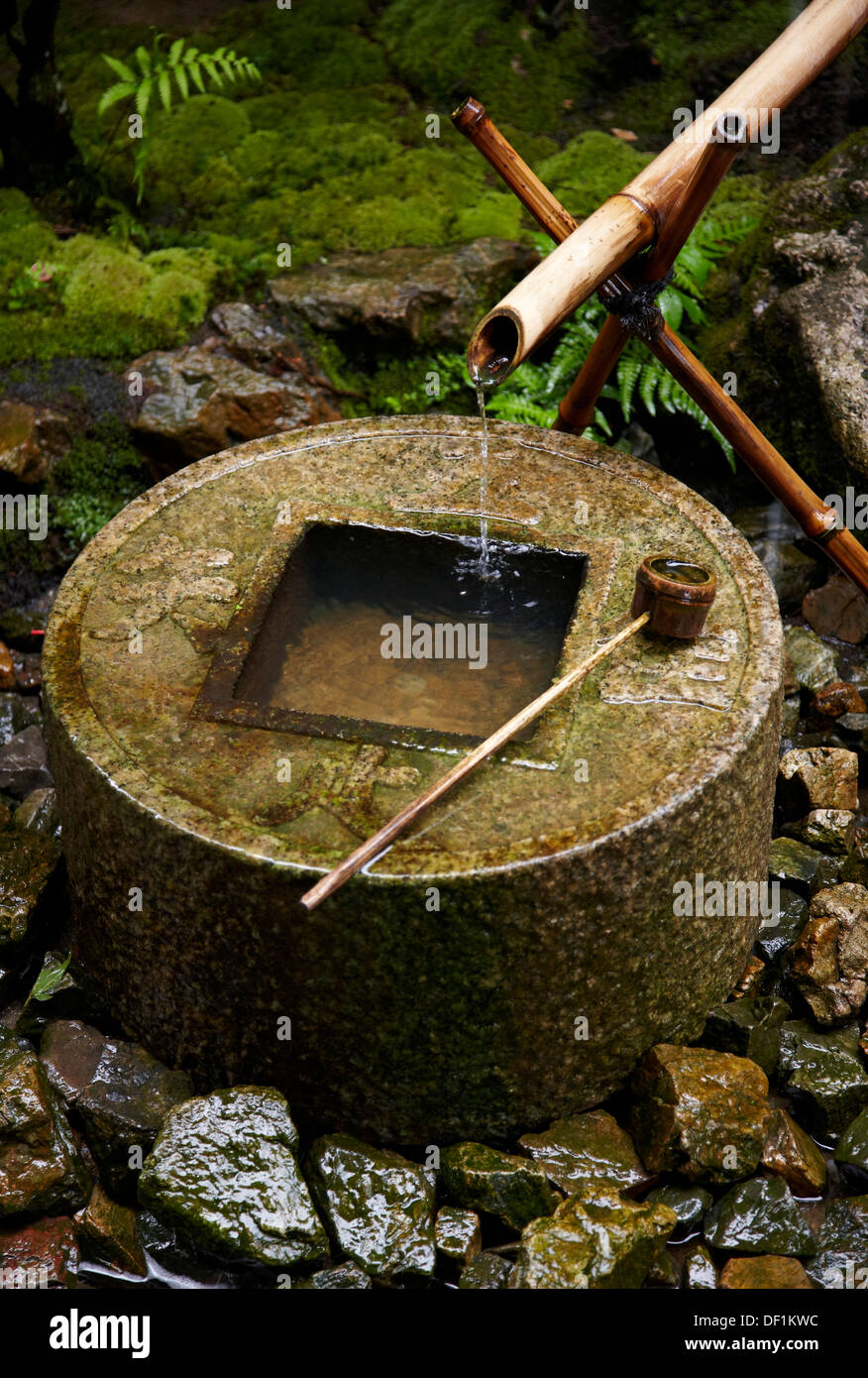 Tsukubai, Stone-wash basin, Zen philosophy, Ryoanji Temple, Kyoto, Japan. - Stock Image