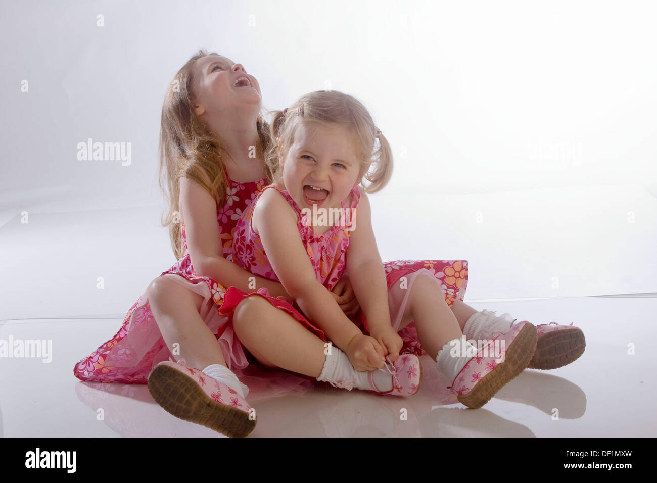 2 Little Girl, Sitting On The Floor, Hugging And Really