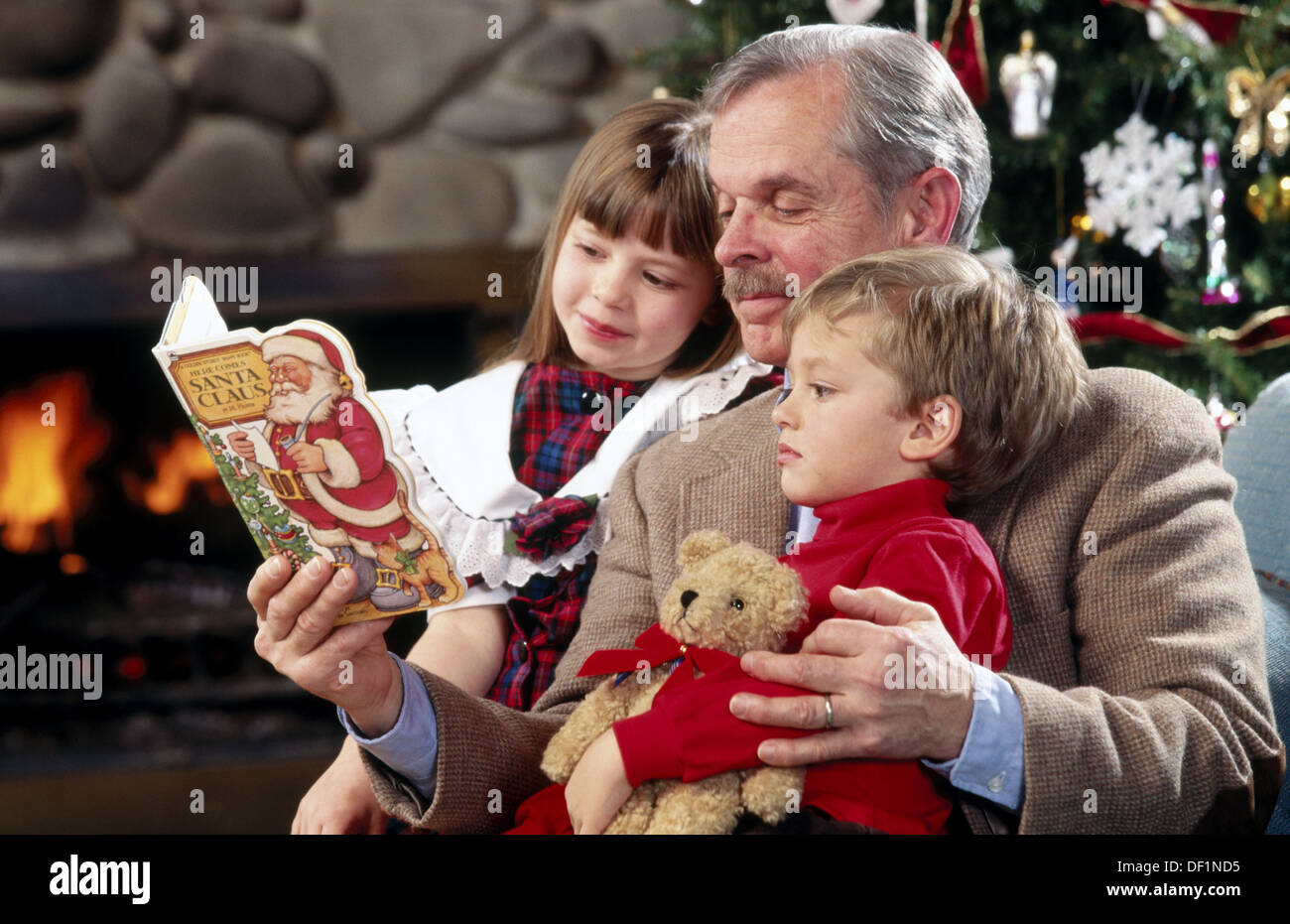 grandpa reading christmas story to children stock image - Grandpa For Christmas
