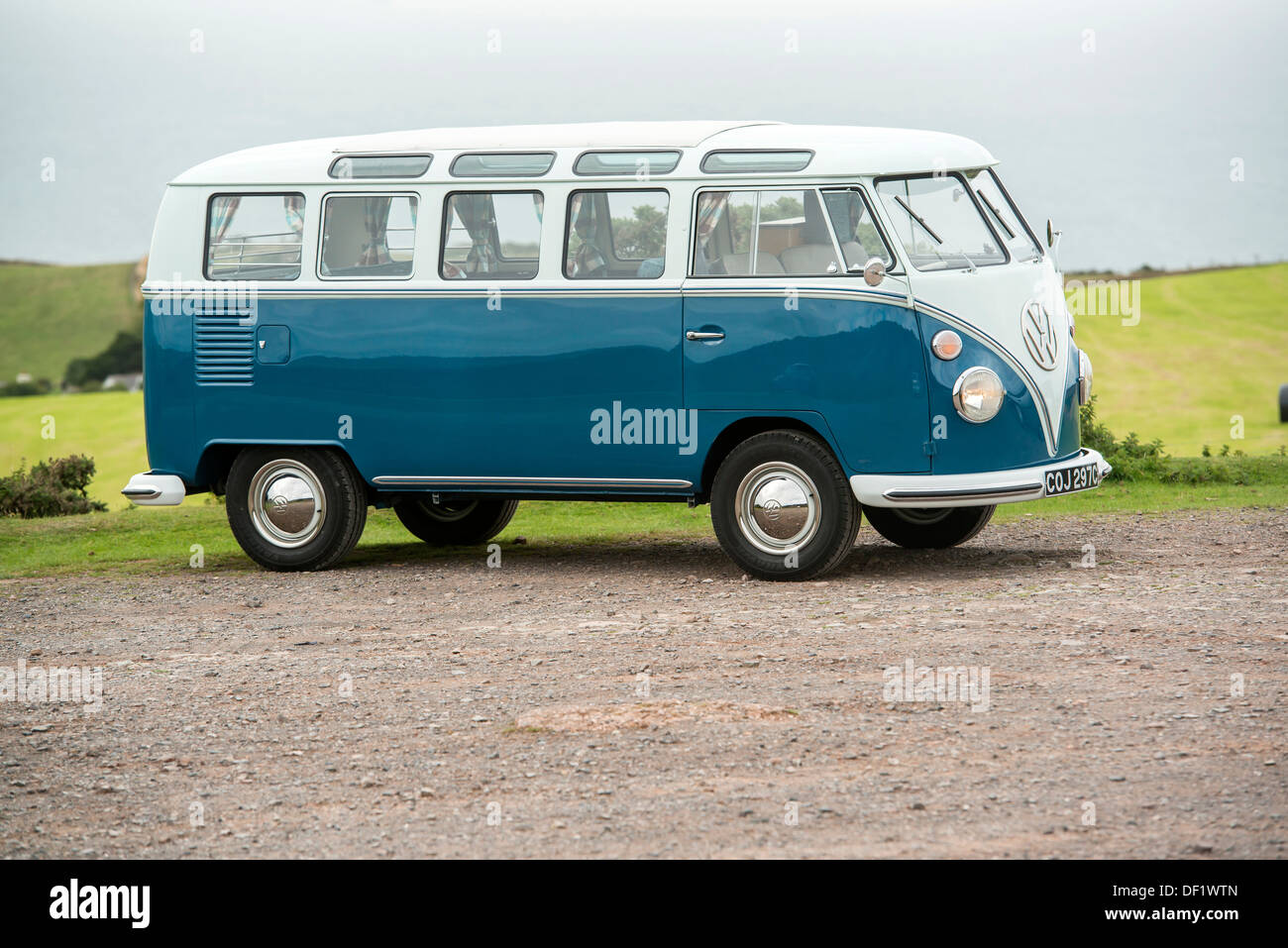a classic VW 1965 original British RHD 21 window caravette campervan pictured in the countryside, Devon, UK - Stock Image