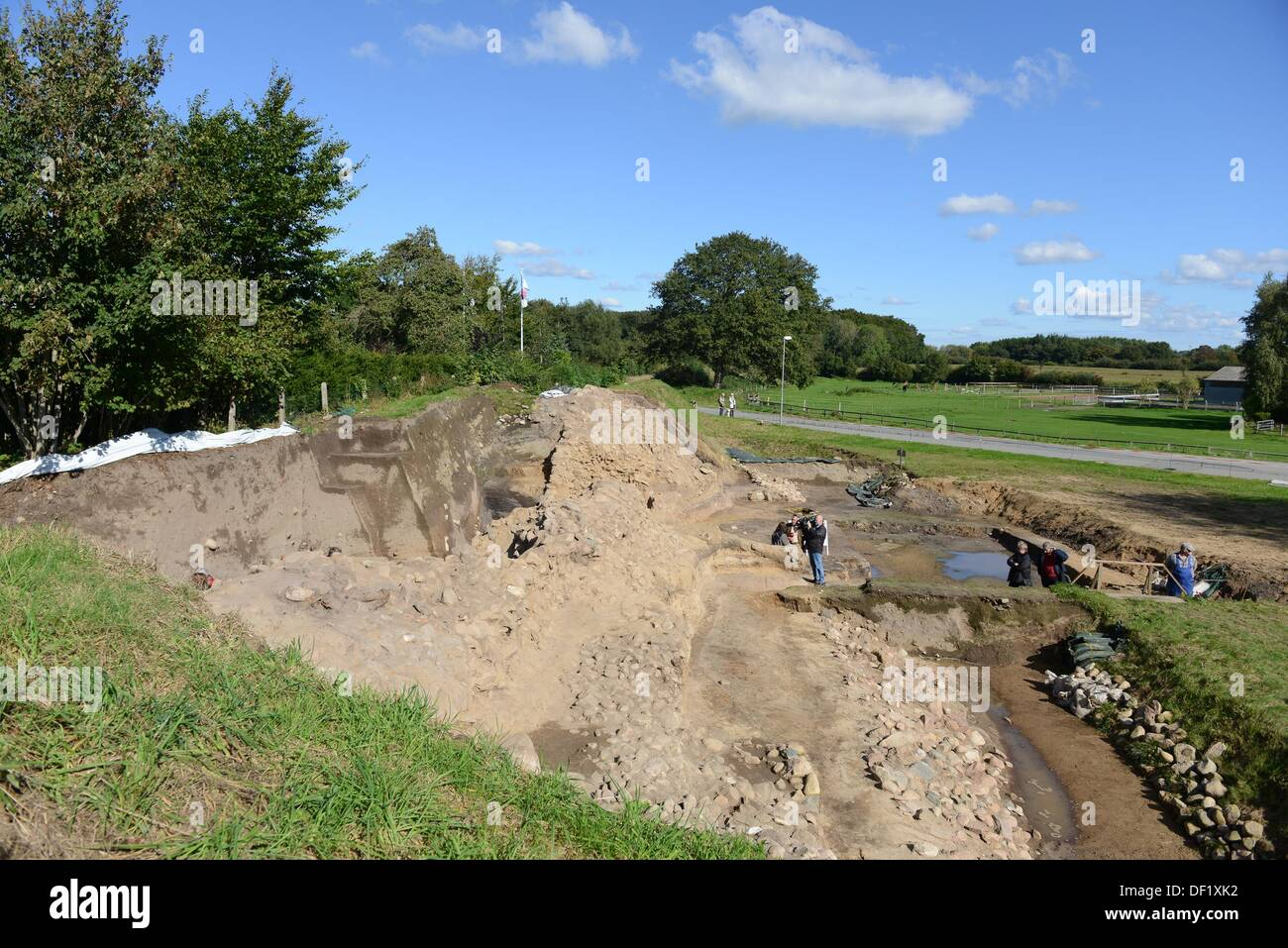 Members of the press inspect a segment of the defensive wall of the archaeological excavation site 'Danewerk' in Dannewerk, Germany, 26 September 2013. The presentation showed a complete cross-section of the early mediaevil defensive wall including archaeological findings of one of northern Europe's largest archaeological heritage sites, which date back to 540 AD. PHOTO: BENJAMIN NOLTE - Stock Image
