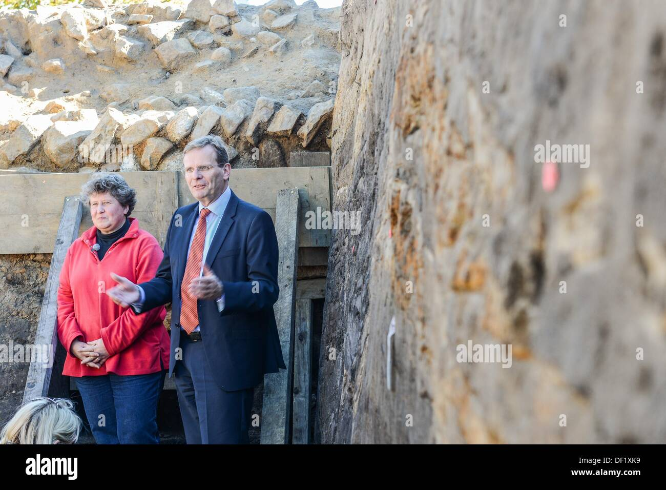 The managing archaeologist, Astrid Tummuscheit, and the director of the Archaeological State Office of Schleswig-Holstein, Claus von Carnap-Bornheim (R),  present a segment of the defensive wall of the the archaeological excavation site 'Danewerk' in Dannewerk, Germany, 26 September 2013. The presentation showed a complete cross-section of the early mediaevil defensive wall including archaeological findings of one of northern Europe's largest archaeological heritage sites, which date back to 540 AD. Photo: Benjamin Nolte - Stock Image