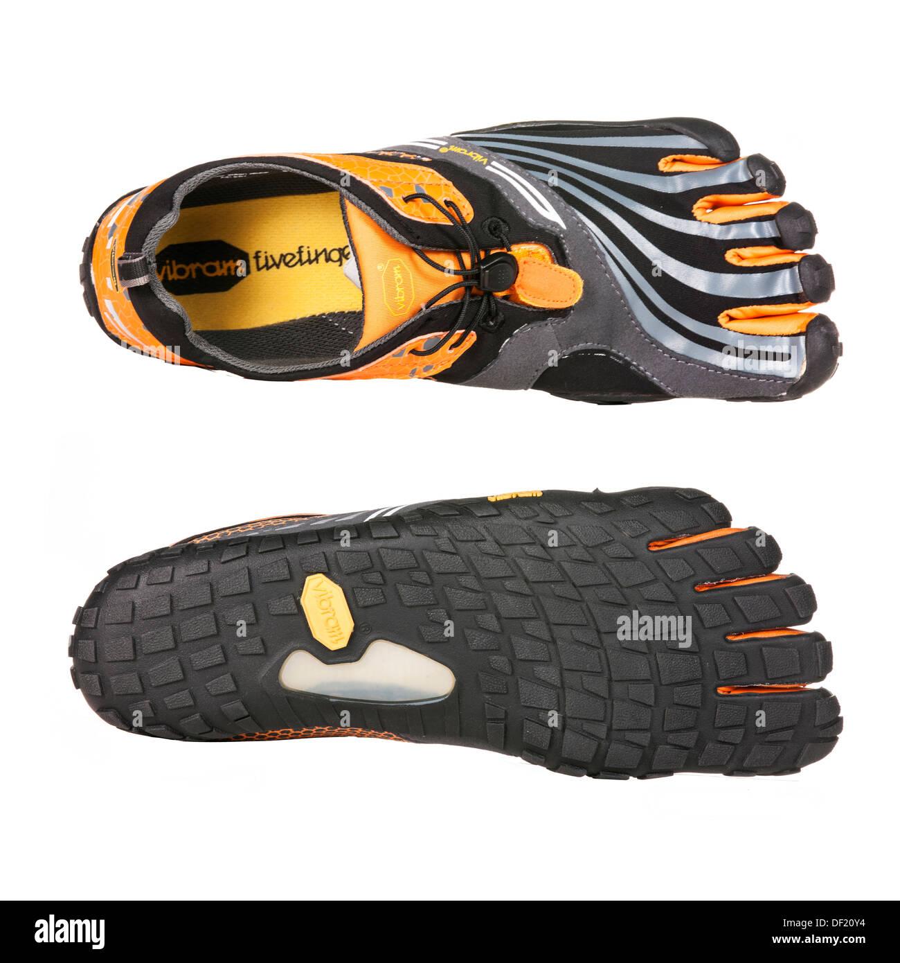 Vibram FiveFingers spyridon ls are barefoot running shoes isolated on white background. Stock Photo