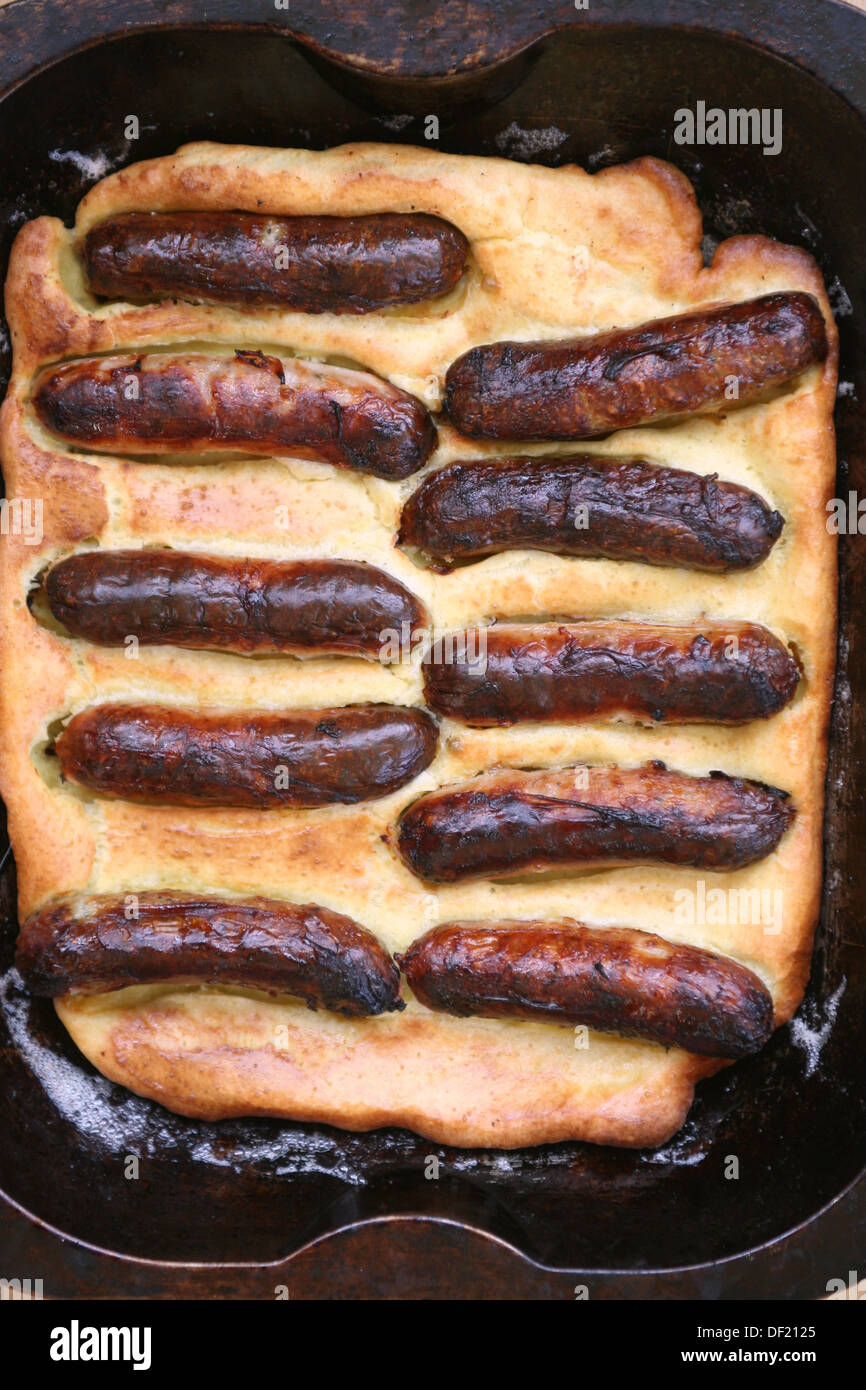 Toad in the hole sausages  in batter - Stock Image