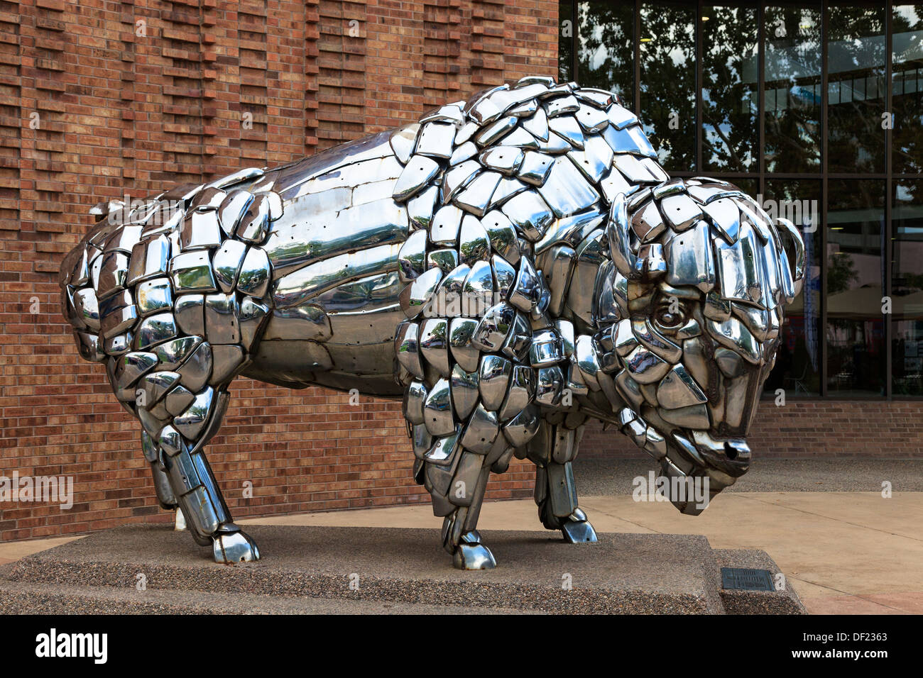 Statue of a bison made from automobile chrome parts, and one of a number of street artworks in downtown Grand Junction, Stock Photo